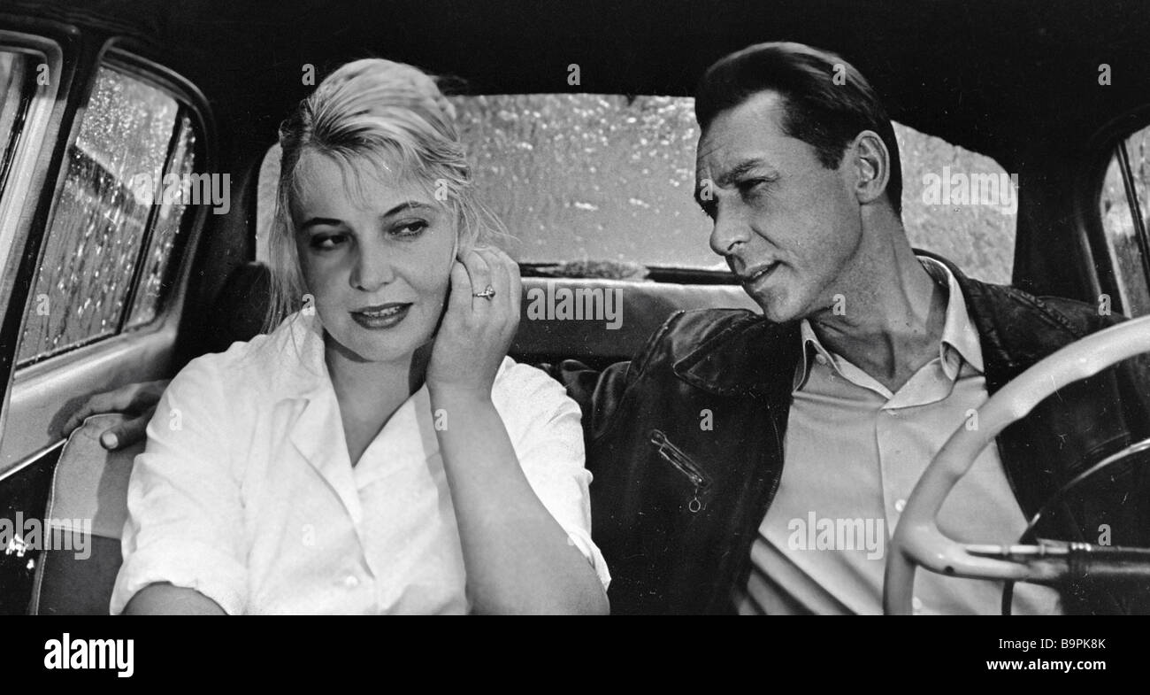 People s Artist of the U S S R Oleg Yefremov as Taxi Driver right and Tatiana Doronina as Nyura left in film Three - Stock Image