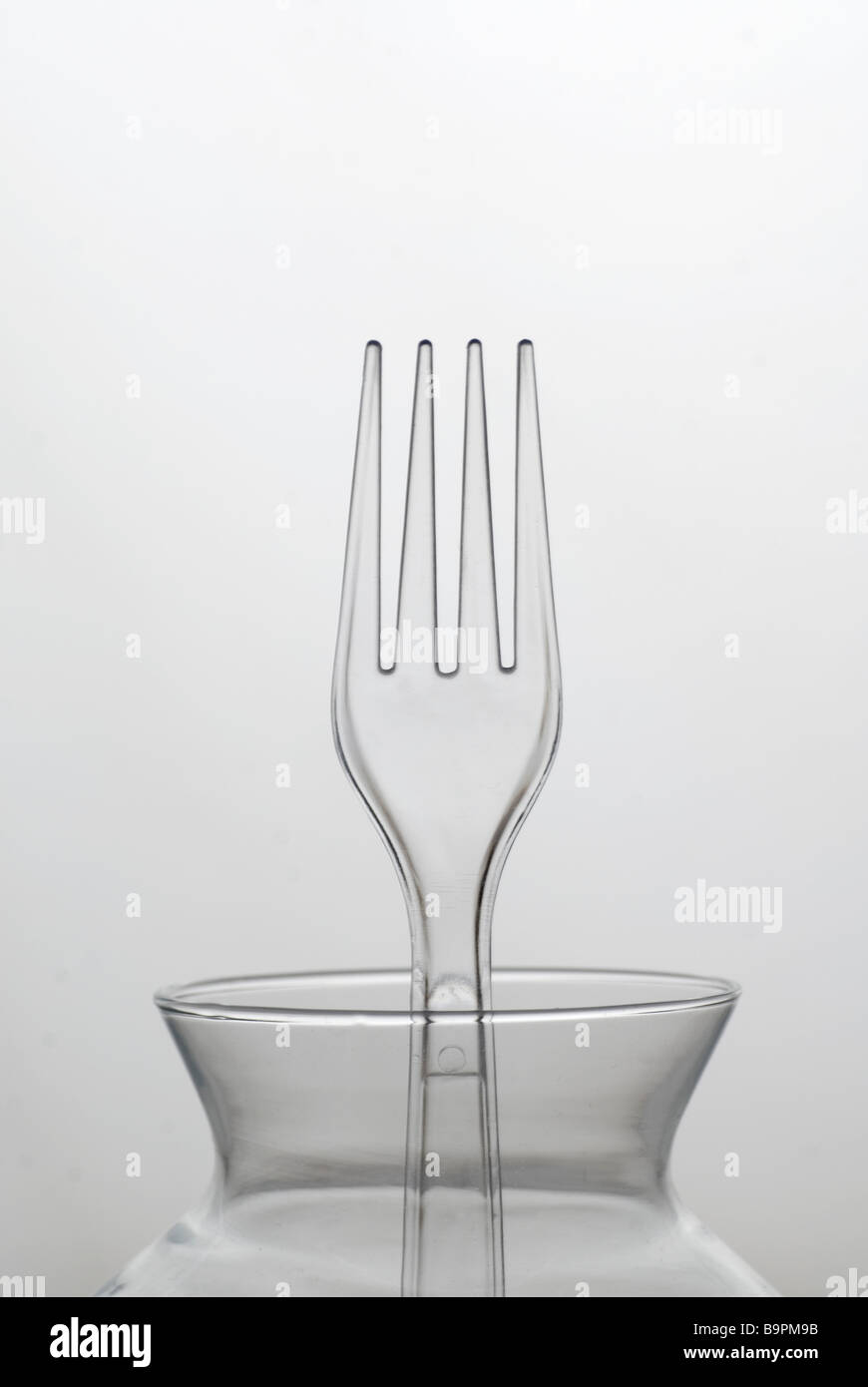 Clear plastic fork against a white background Stock Photo