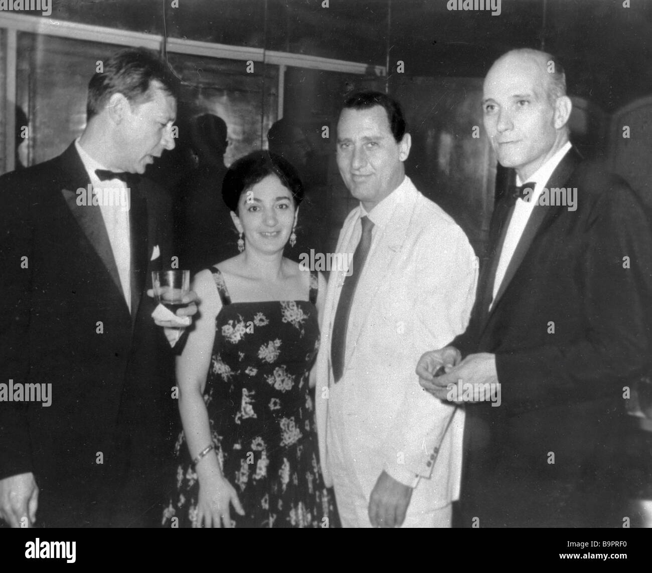 Actor and director Oleg Yefremov film director Tatyana Lioznova and Italian actor Alberto Sordi left to right at - Stock Image