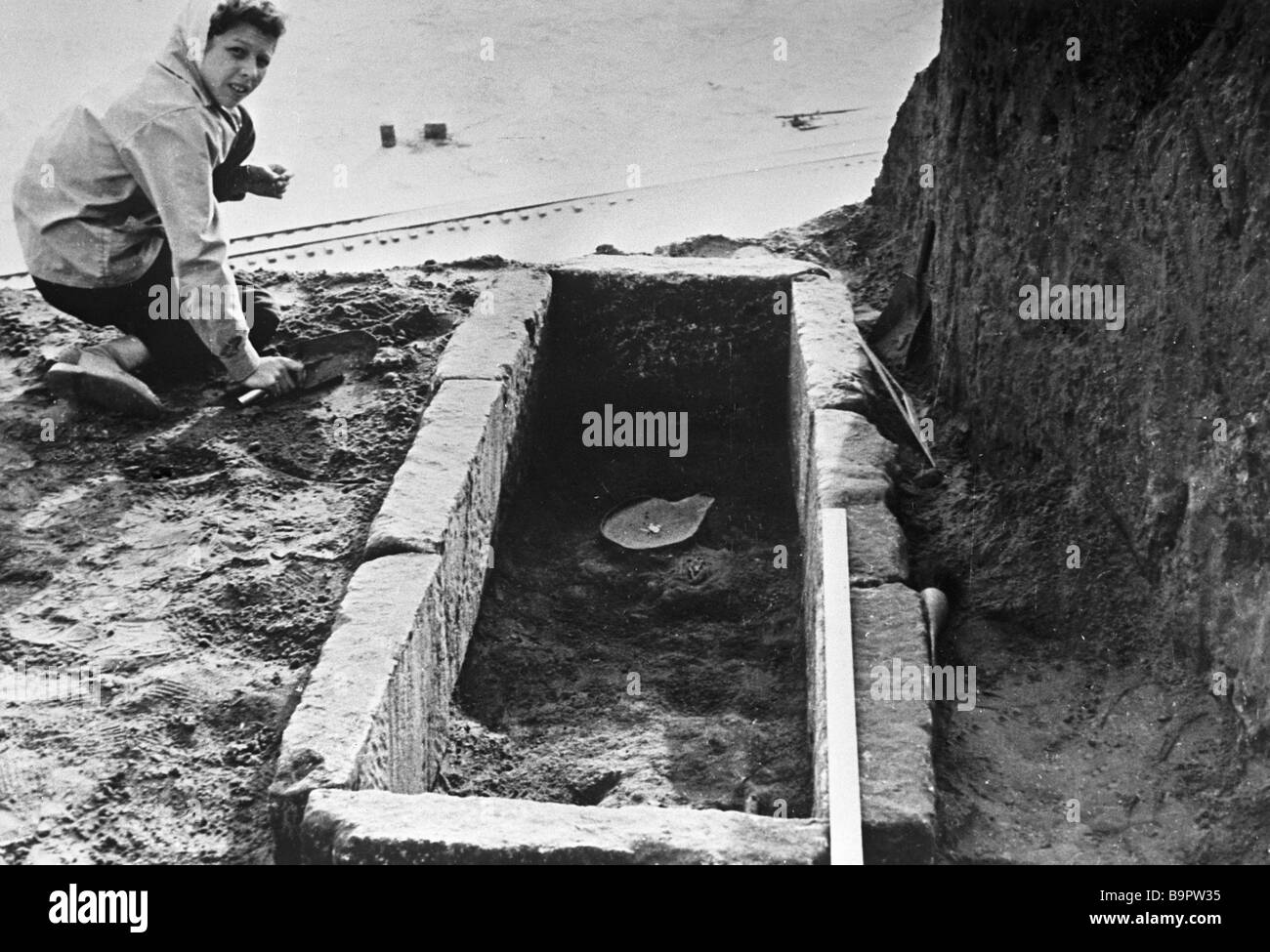 Cleaning up a 2nd century BC underground stone tomb - Stock Image