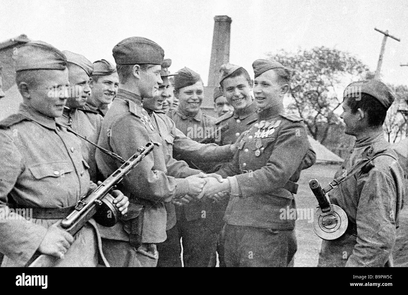Soldiers congratulating Sergeant Major M Afanasenko holder of the Glory Order of all classes The 1st Far Eastern - Stock Image