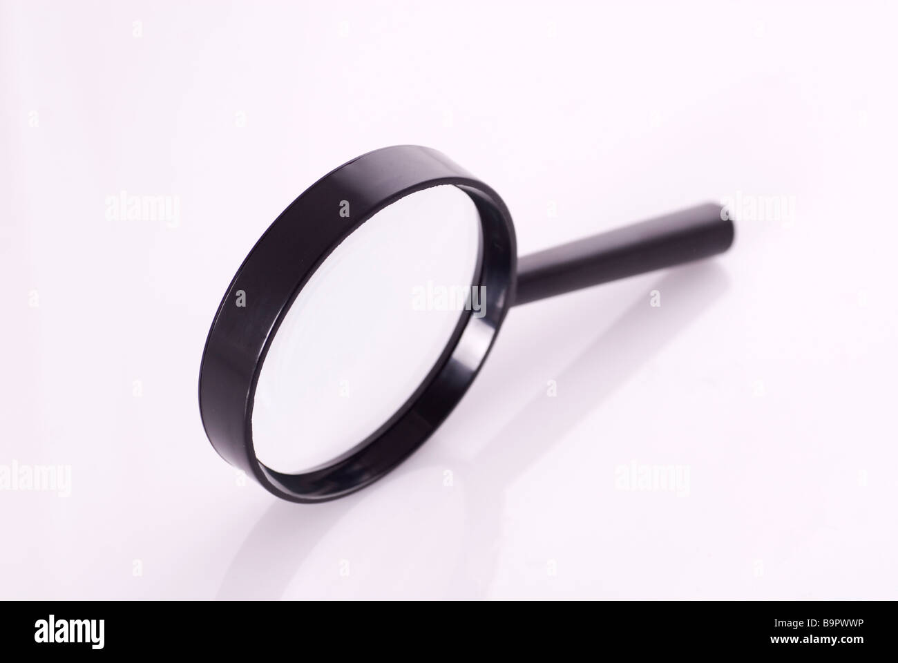 Magnifying glass isolated on a white background - Stock Image