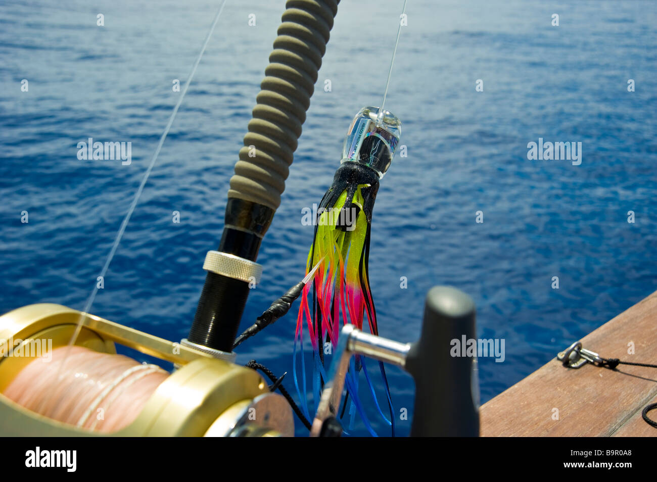 Big game fishing reel with lure on fishing boat La Réunion France | Hochsee-Angel mit Rolle und Köder auf Angelboot, Stock Photo