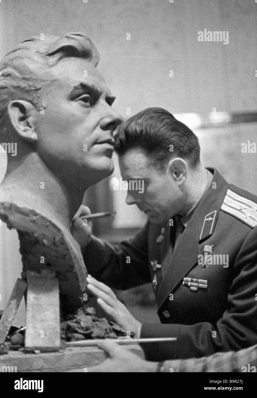 Pilot Cosmonaut Vladimir Komarov signing his name on his sculptural portrait by Postnikov - Stock Image