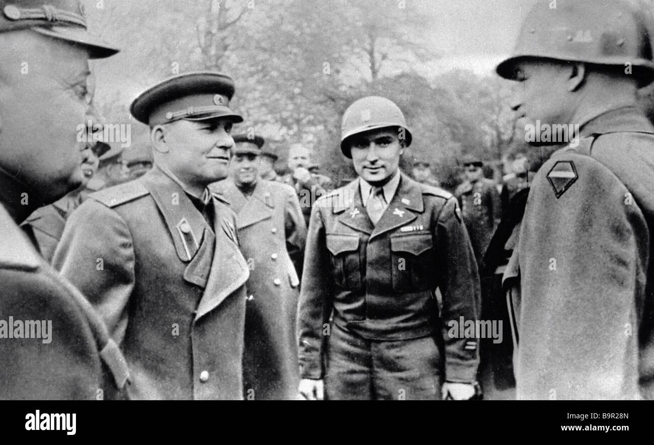 Marshal of the Soviet Union Ivan Konev second from left and General of the Army Ivan Petrov left talking to U S - Stock Image