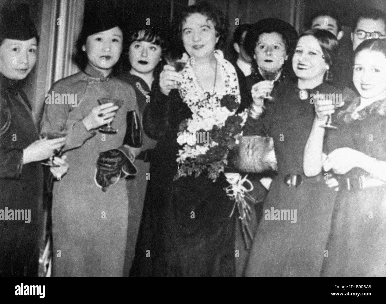 Diplomat Alexandra Kollontai centre with the delegates of the Women of the East conferenceStock Photo