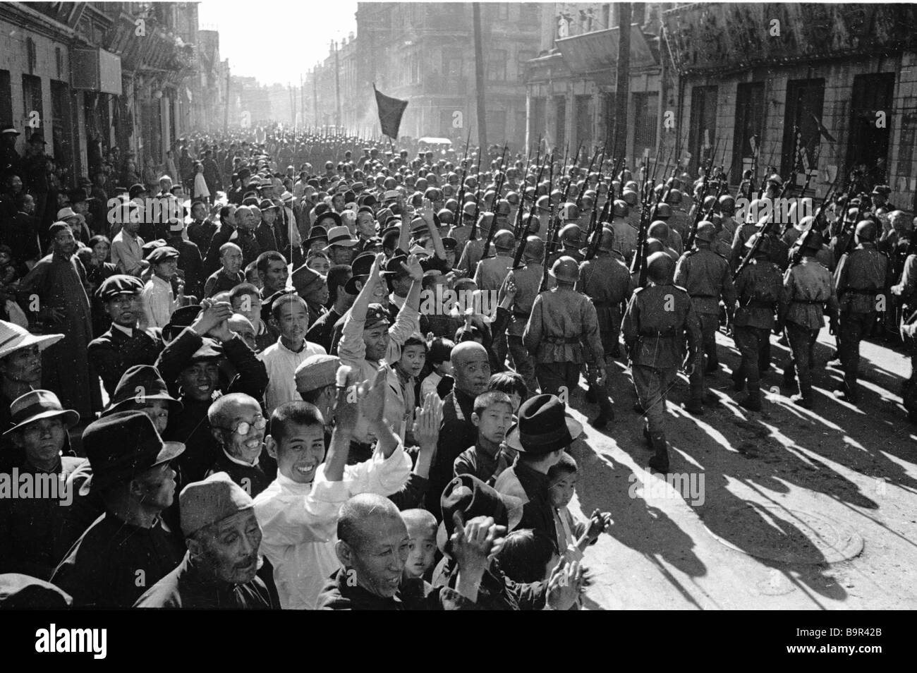 People of Harbin greeting Soviet soldiers of the 1st Far Eastern Front - Stock Image