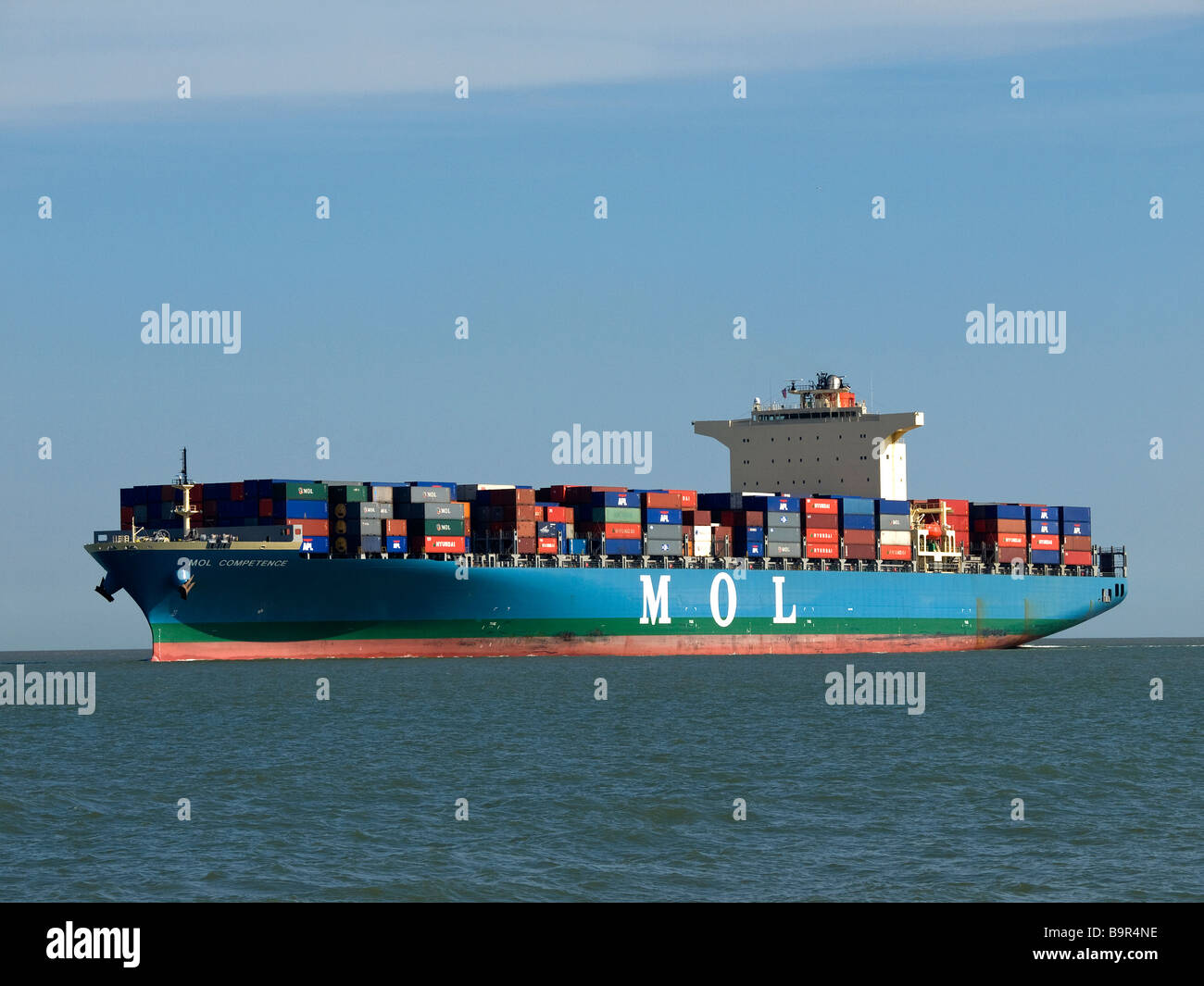 Lightly loaded container ship MOL Competence arriving at Southampton UK - Stock Image