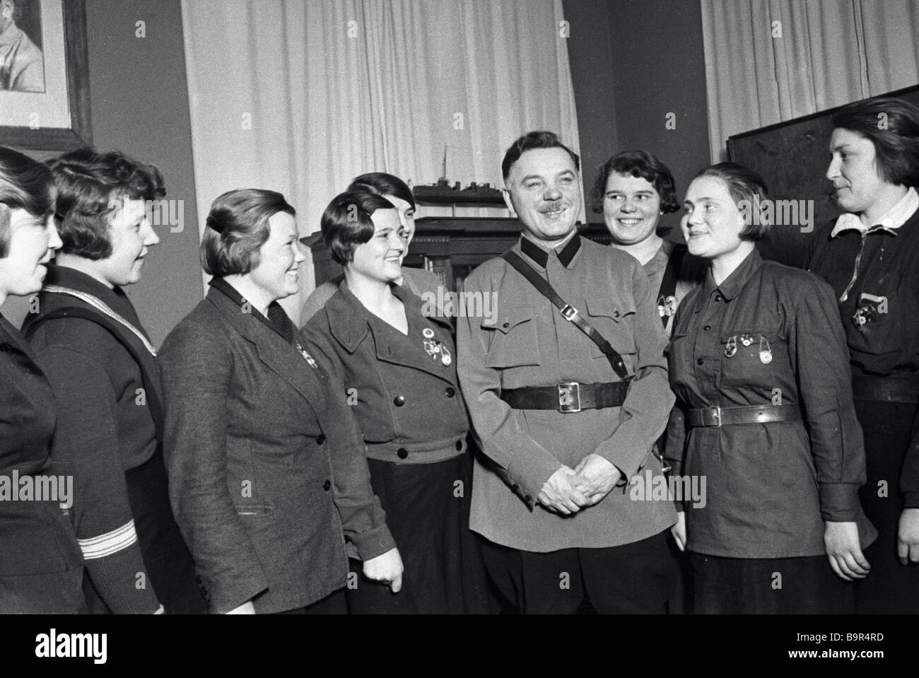 USSR Commissar of Defense Kliment Voroshilov fourth right has a meeting with young Communist League members awarded Stock Photo