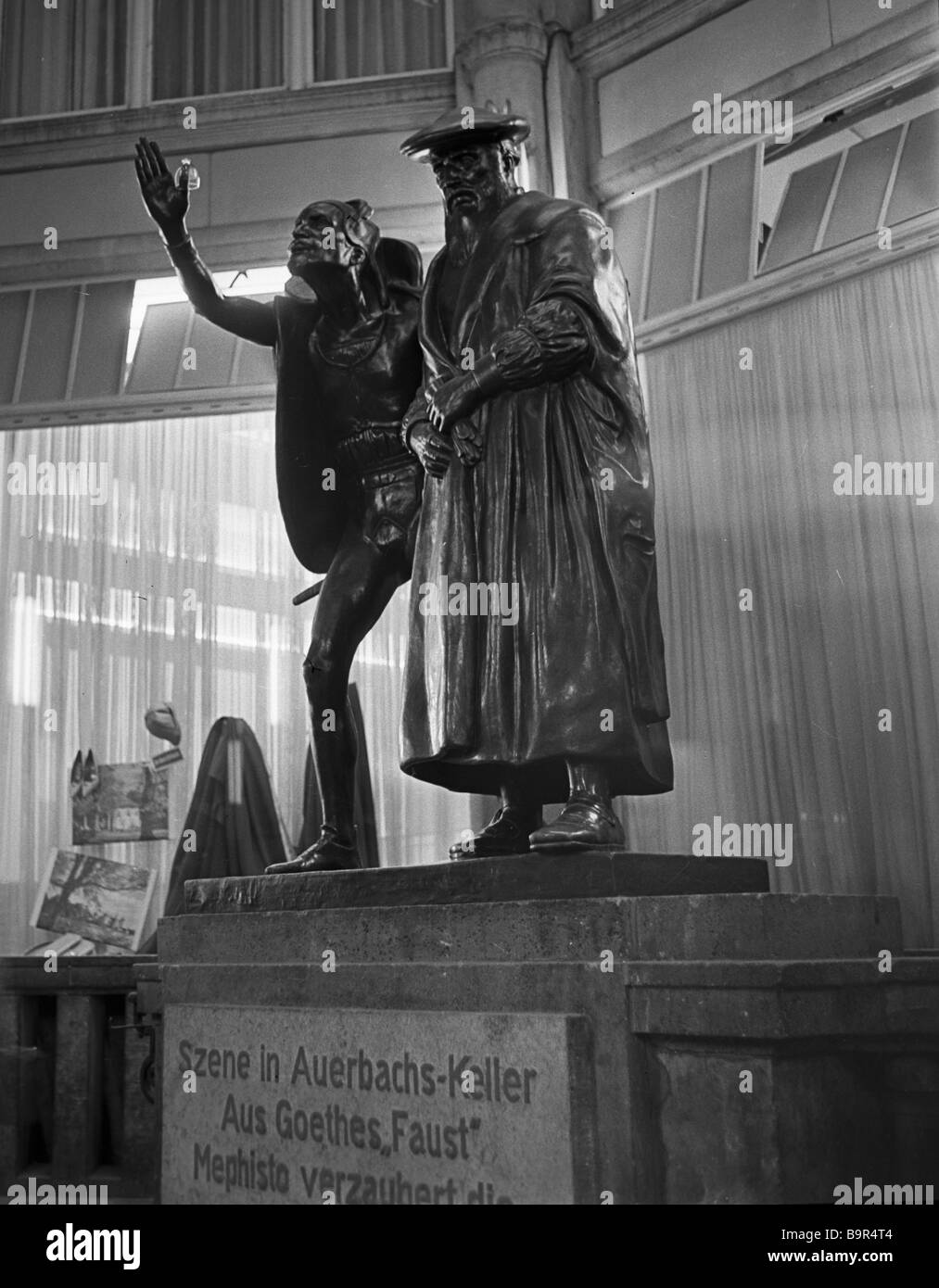 Sculpture Faust and Mephistopheles at the entrance to Auerbach s Keller - Stock Image