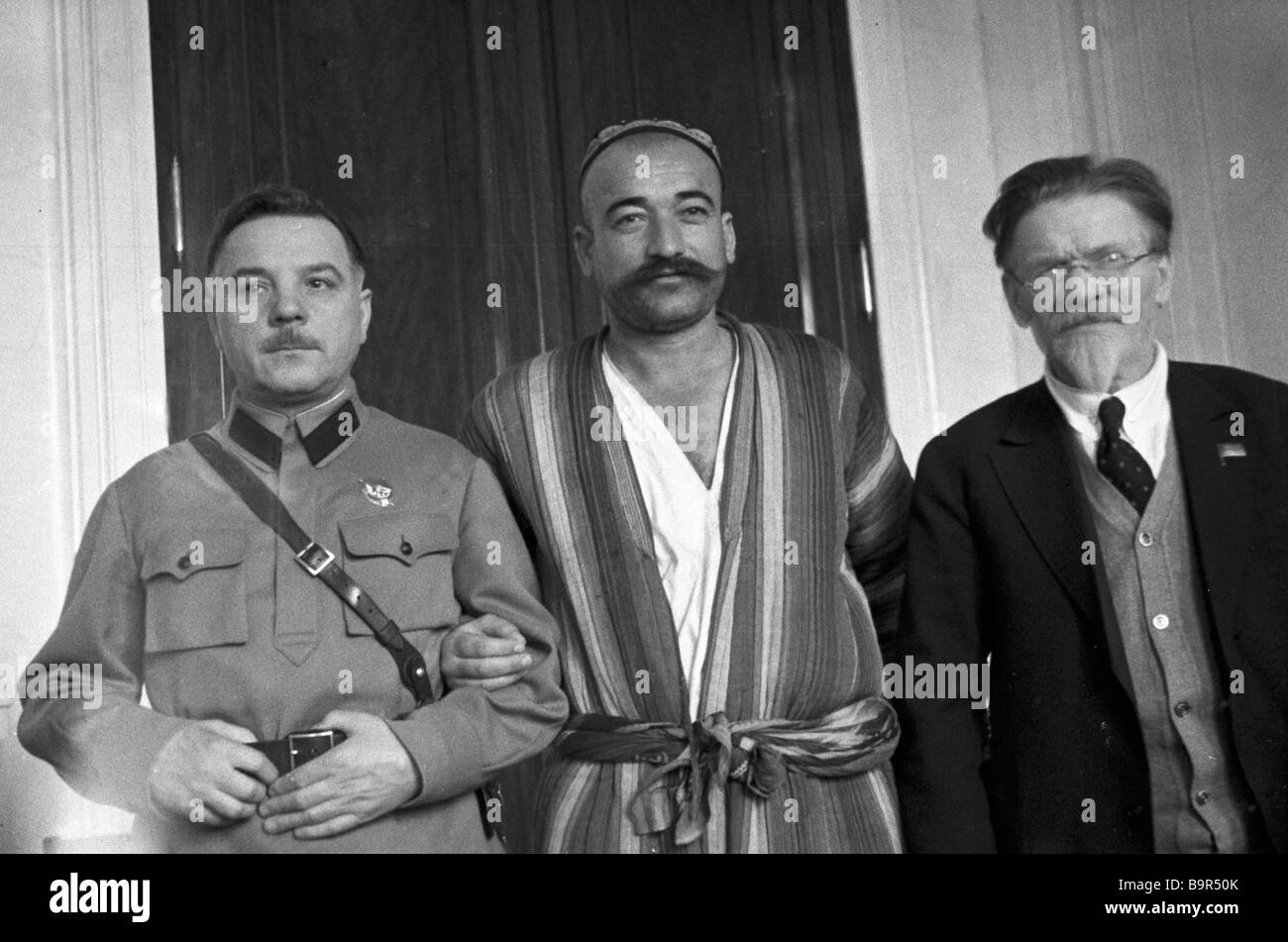 Defense commissar K Voroshilov left and chairman of the Central Executive Committee M Kalinin right at the 2nd congress - Stock Image