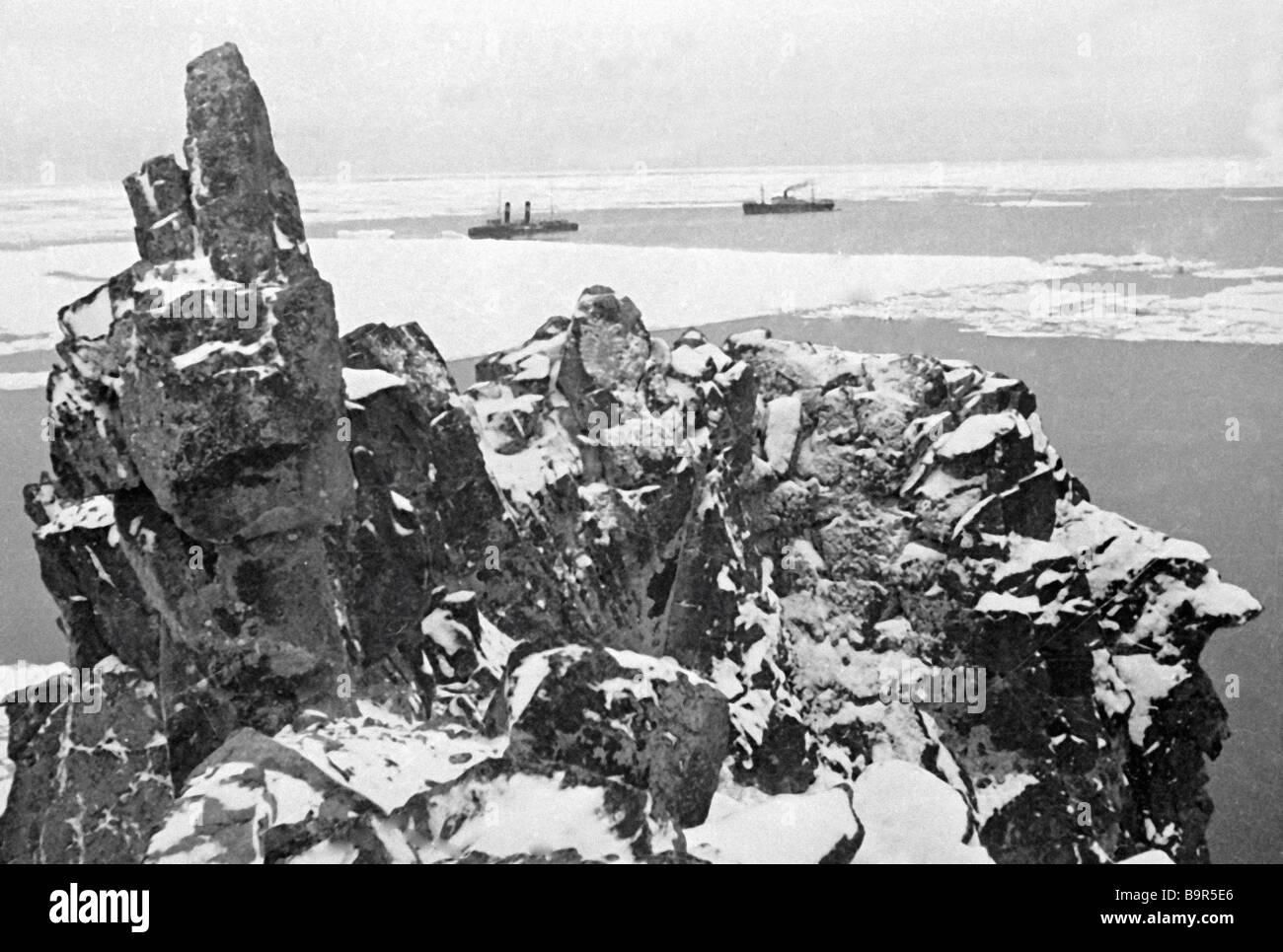The icebreaker Krasin and steamer Sverdlovsk at anchored near Cape Schmidt - Stock Image