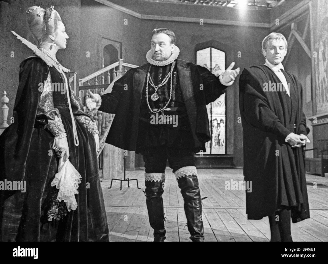 Actors Innokenty Smoktunovsky right as Hamlet Mikhail Nazvanov center as Claudius and Elza Radzinya left as Queen - Stock Image