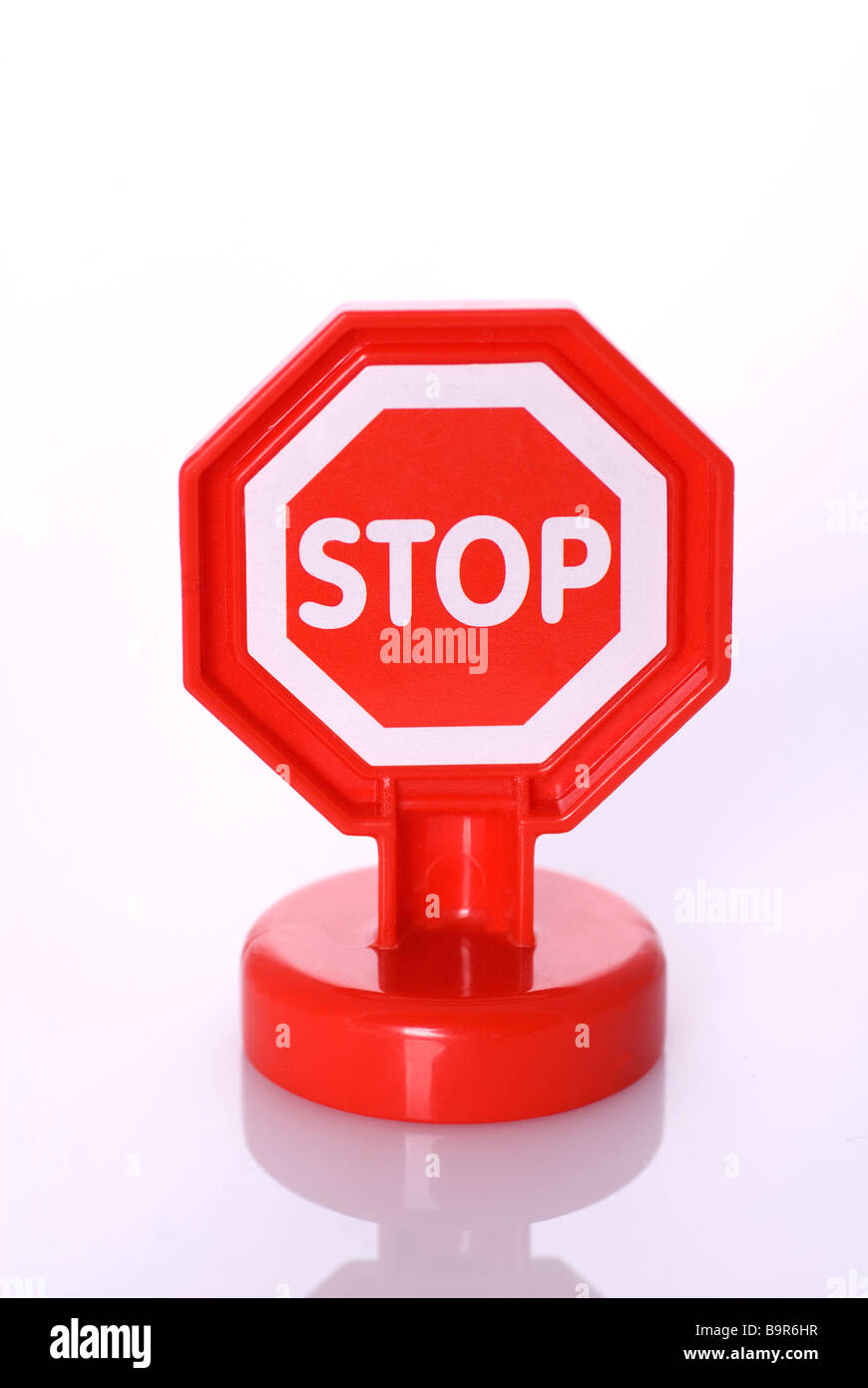Stop sign toy against a white background - Stock Image