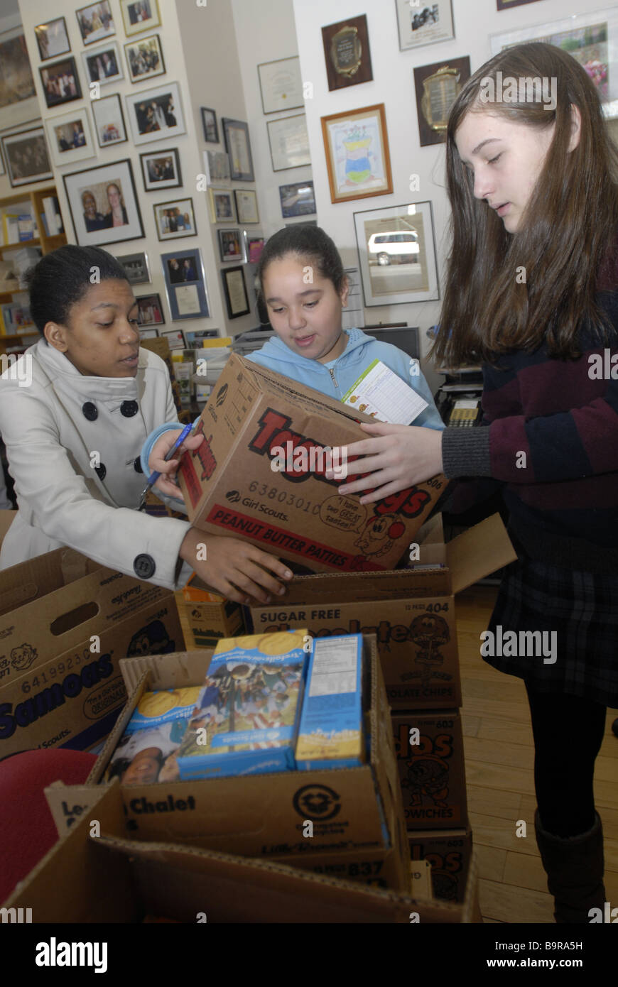 Girl scouts and volunteers sort inventory and distribute Girl Scout cookies sold by Upper West Side Troop 3068 in - Stock Image