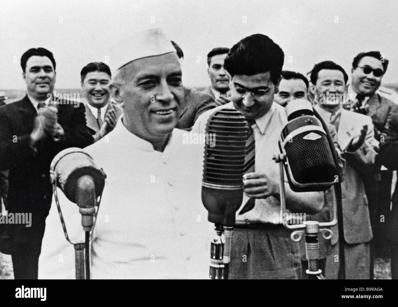 Indian Prime Minister Jawaharlal Nehru left foreground being met by Leonid Brezhnev left background the first secretary - Stock Image