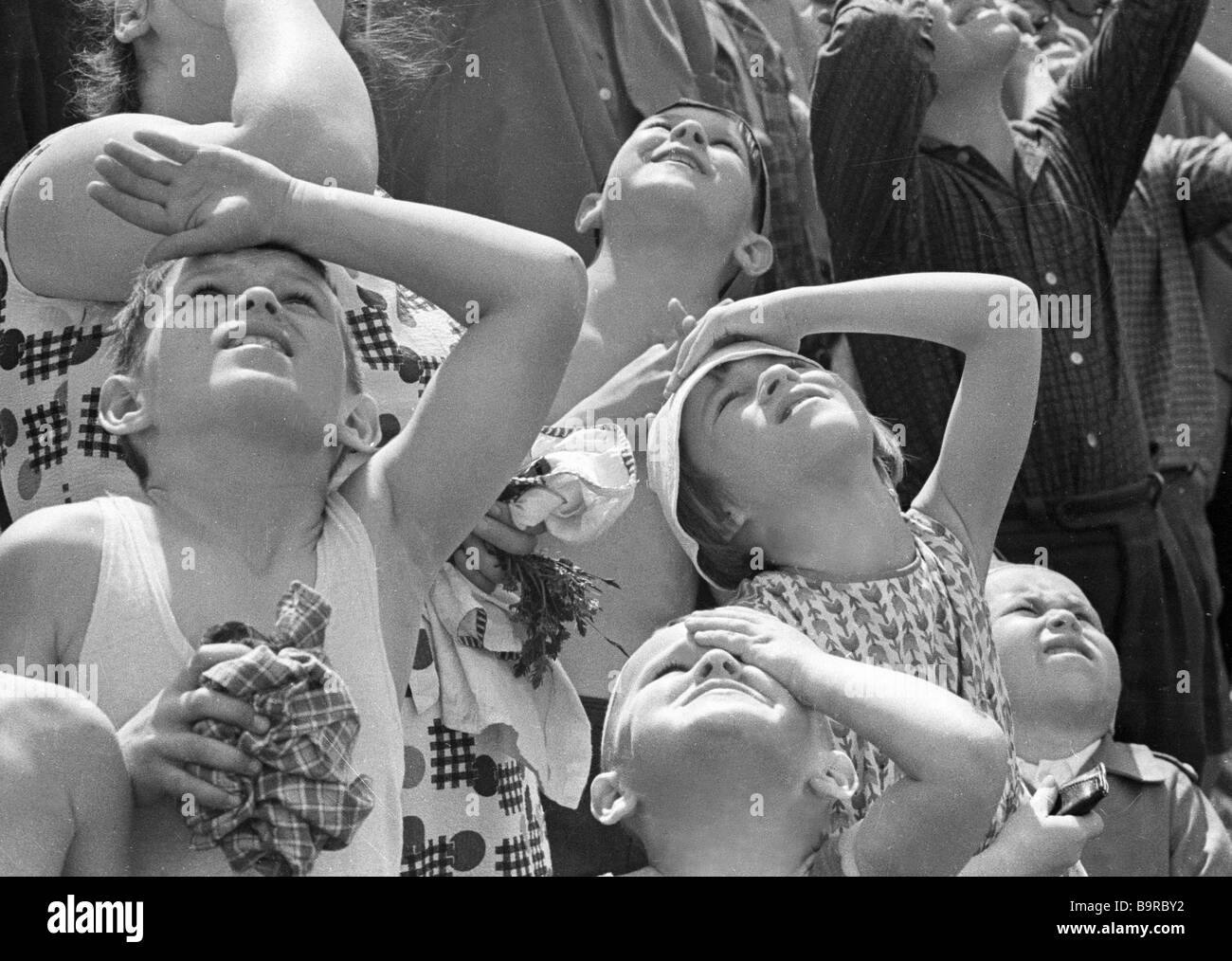 Spectators watching flying planes - Stock Image