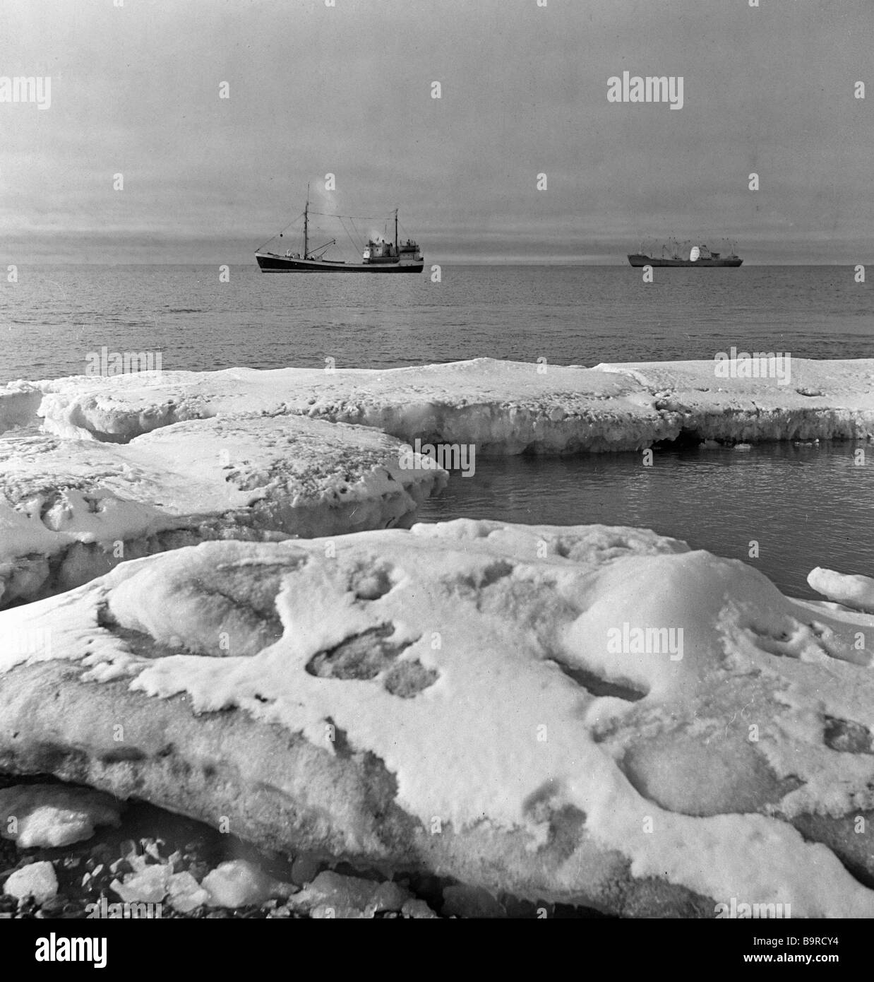 Ships in a harbor Cape Svyatoy Nos in Arctic - Stock Image