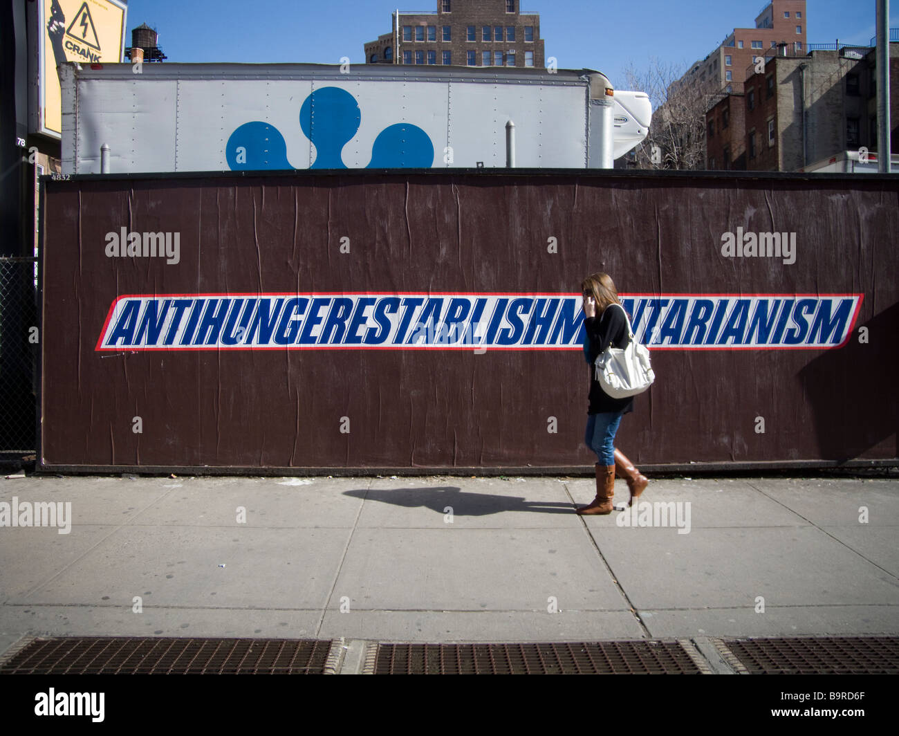 A Snickers Speak billboard for Snickers candy bars is seen in the Chelsea neighborhood of New York - Stock Image