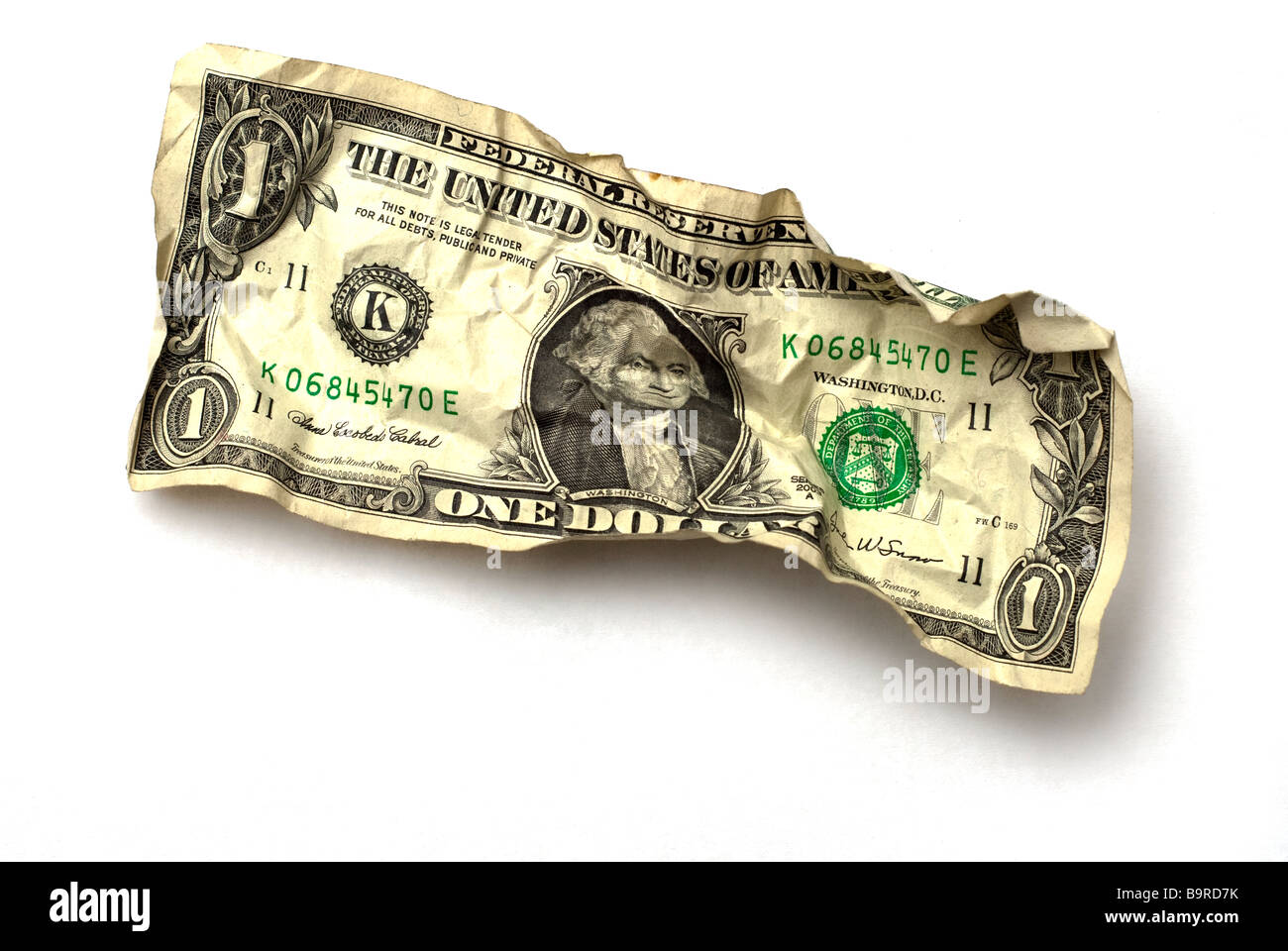 crumpled dollar bill on white background - Stock Image