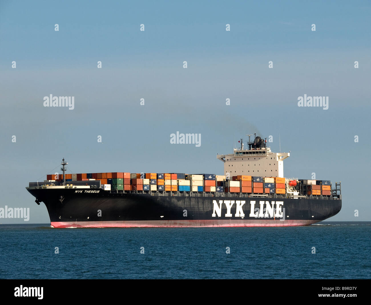 Lightly loaded container ship NYK Theseus arriving at Southampton UK -  Stock Image