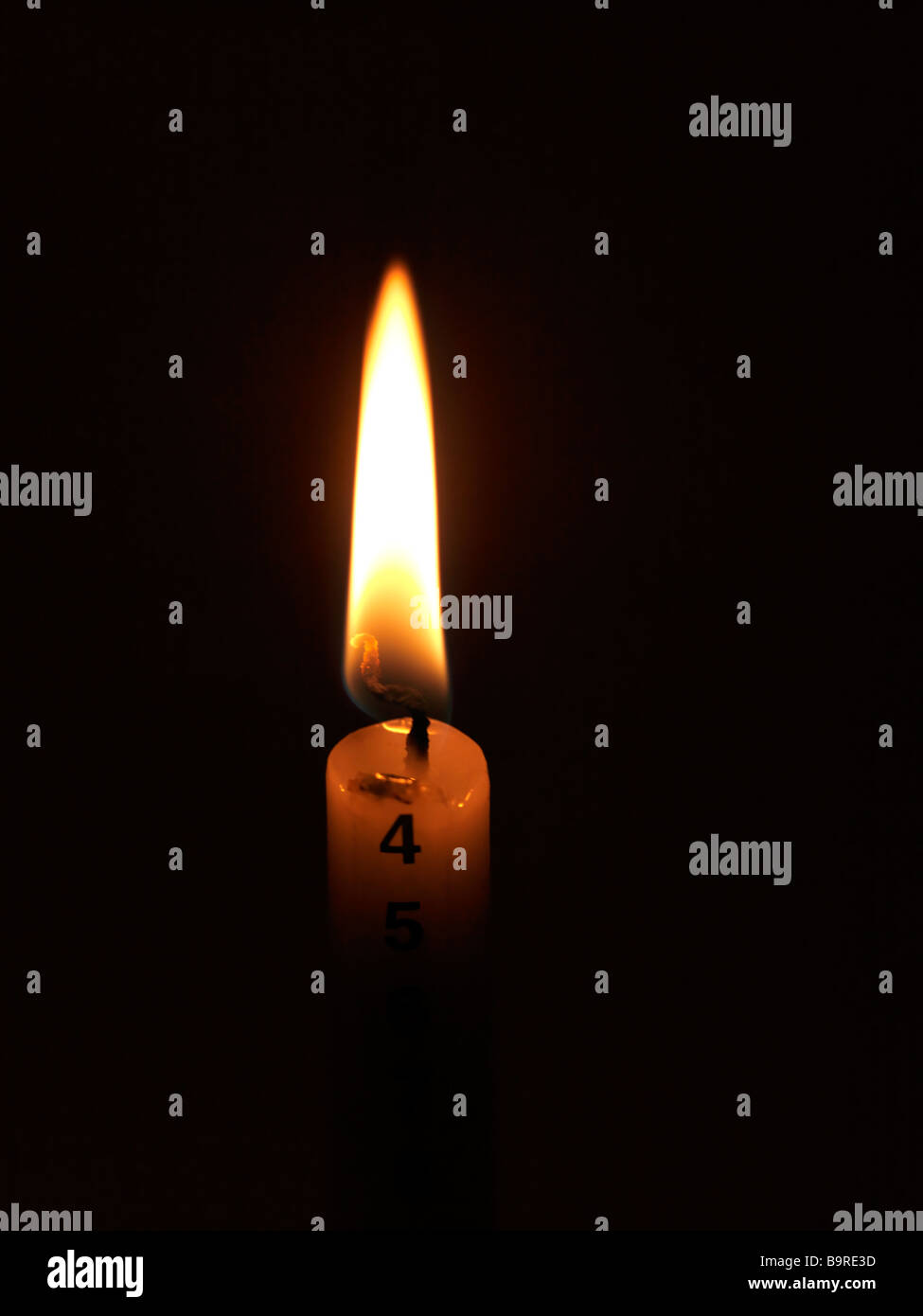 Advent Candle Burning to 4th December St John the Baptist Day - Stock Image