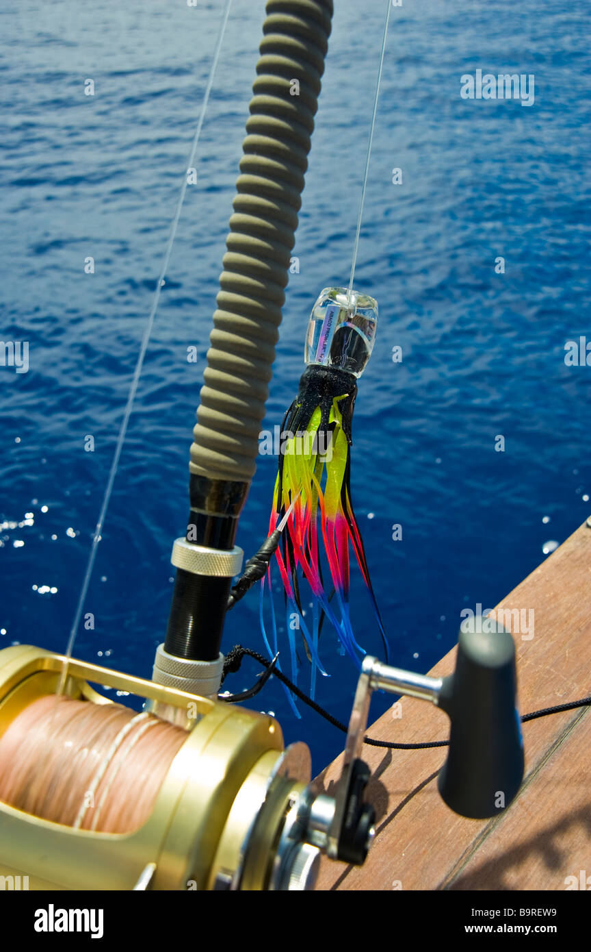 Big game fishing reel with lure on fishing boat La Réunion France   Hochsee-Angel mit Rolle und Köder auf Angelboot, Stock Photo