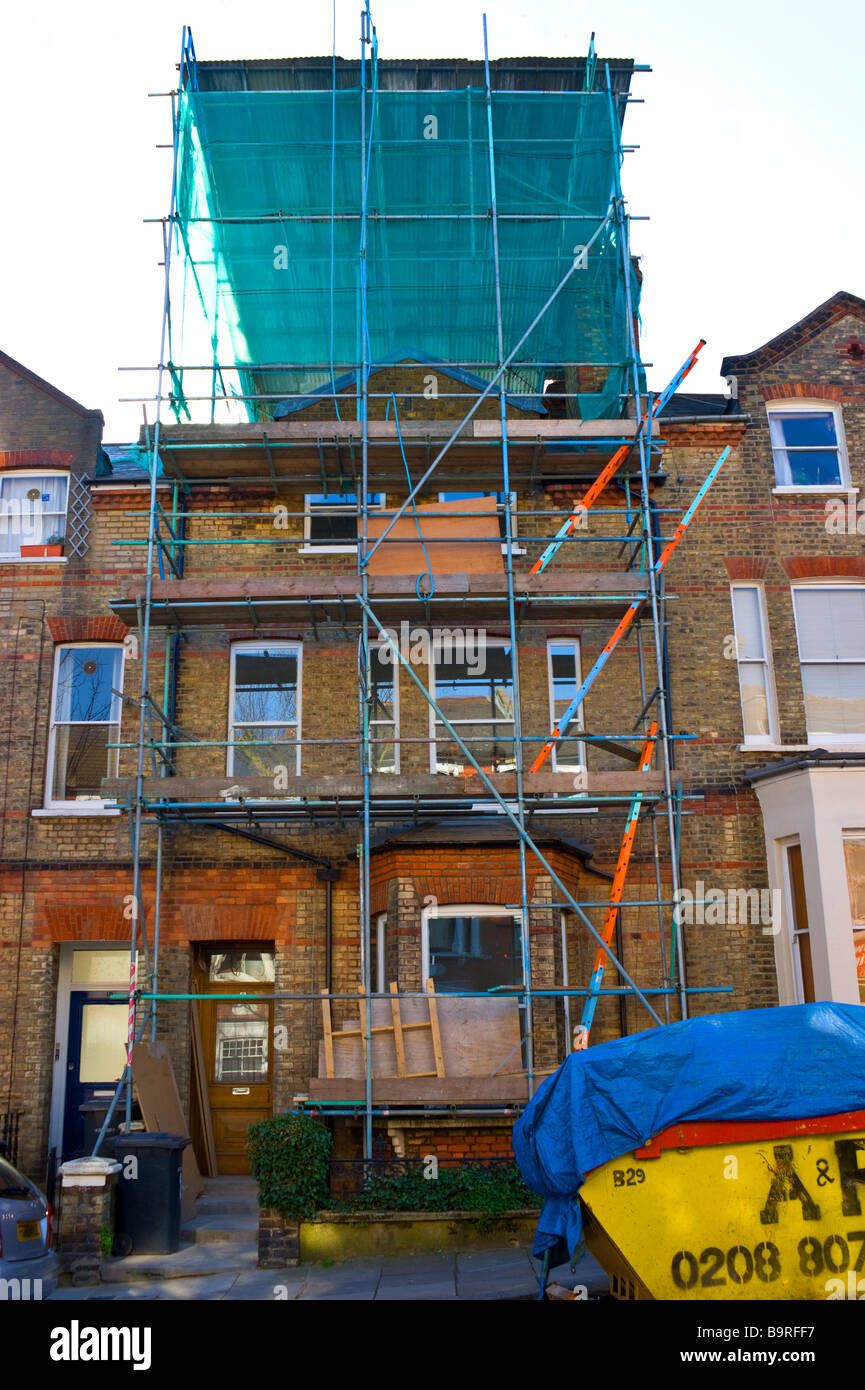 Terraced house in a residential street in Highgate, North London during extensive renovation works . Stock Photo