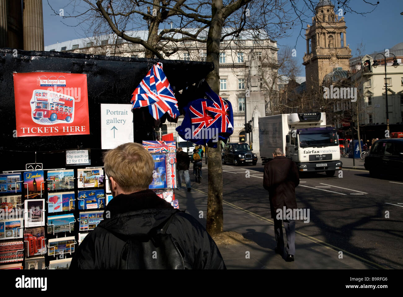 Man looking at postcards Charing Cross Road London England - Stock Image