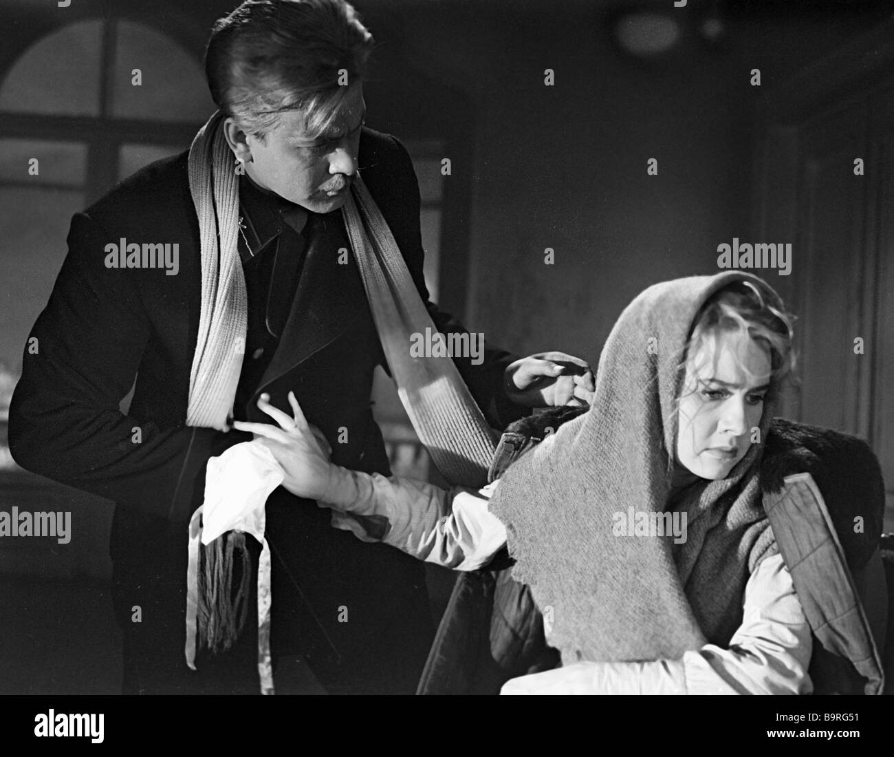 Nina Veselovskaya right as Dasha and Vadim Medvedev left as Ivan Telegin in the movie The year 1918 - Stock Image