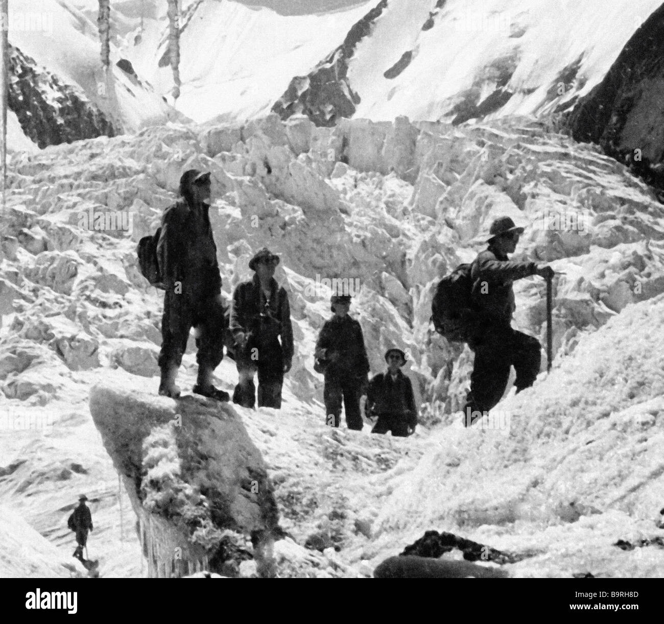 Mountaineers climb the Lenin Peak Stock Photo