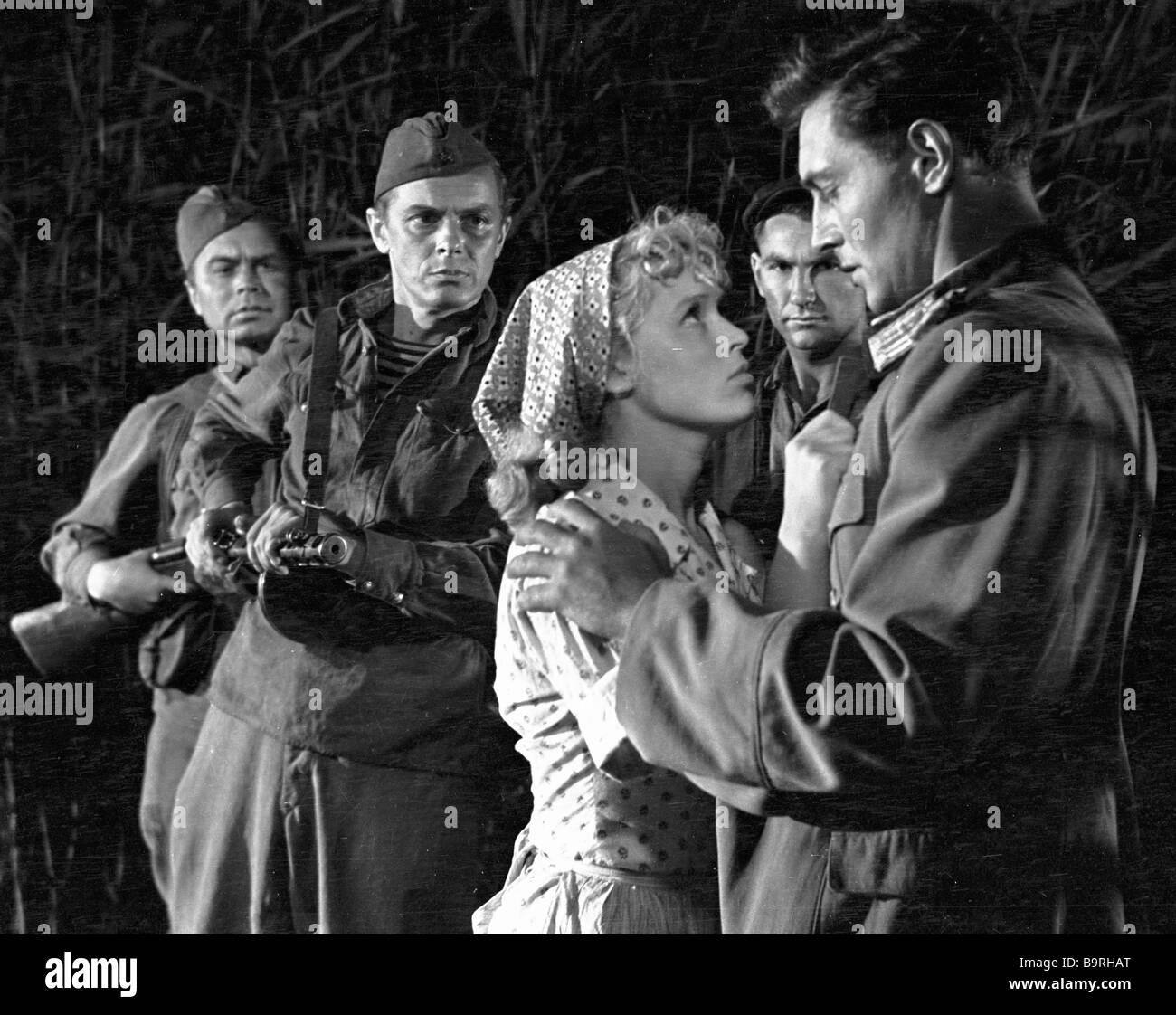 A scene from the film Thirst Vyacheslav Tikhonov right as Oleg Bezborodko and Valentina Khmara left foreground as - Stock Image