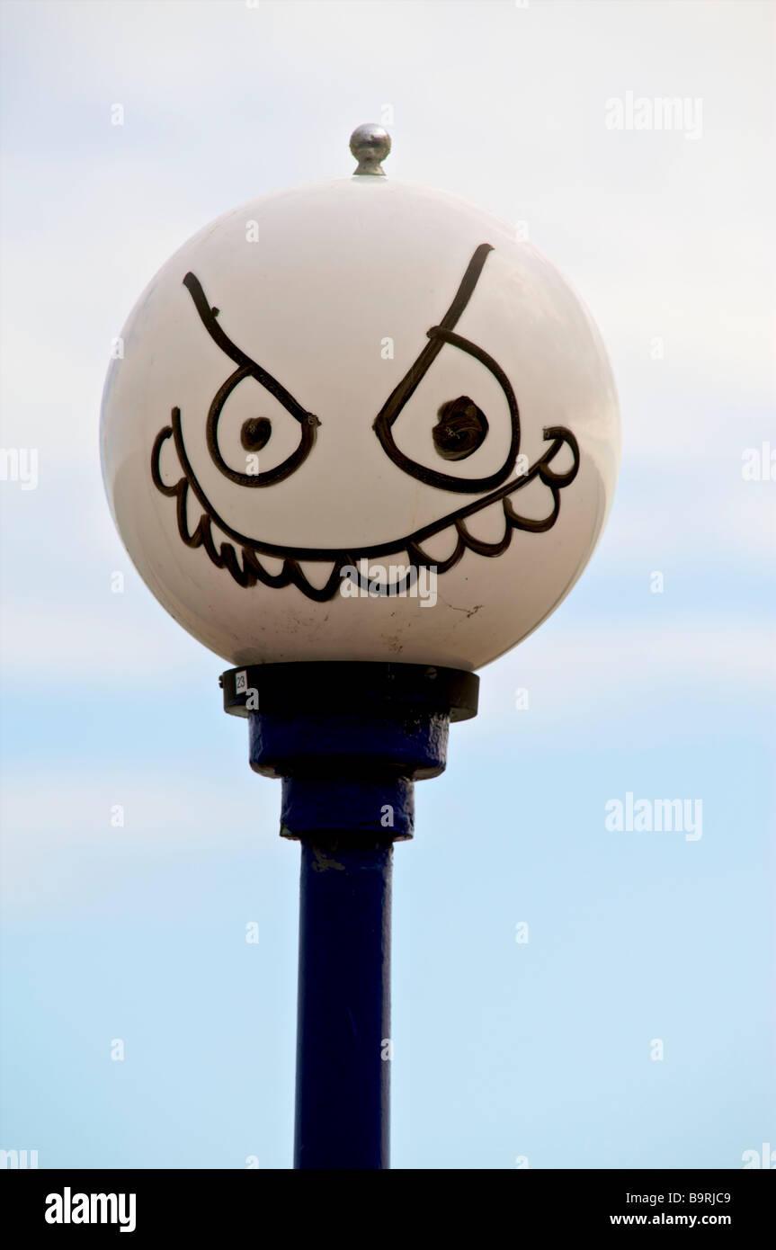 Funny face drawn on streetlight, Eastbourne East Sussex - Stock Image