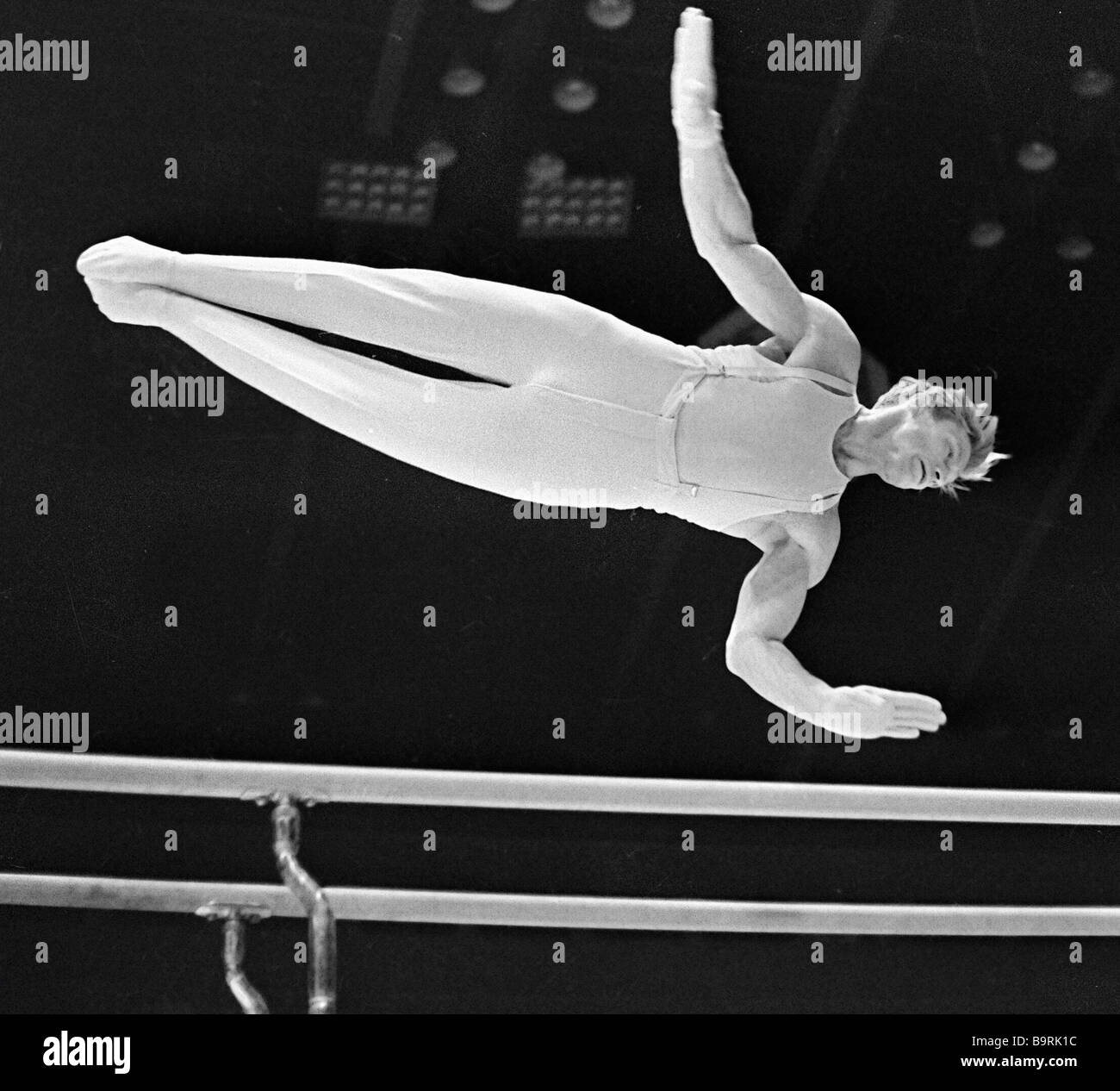 17th Olympic Games champion gymnast Boris Shakhlin executing exercises on the bars - Stock Image