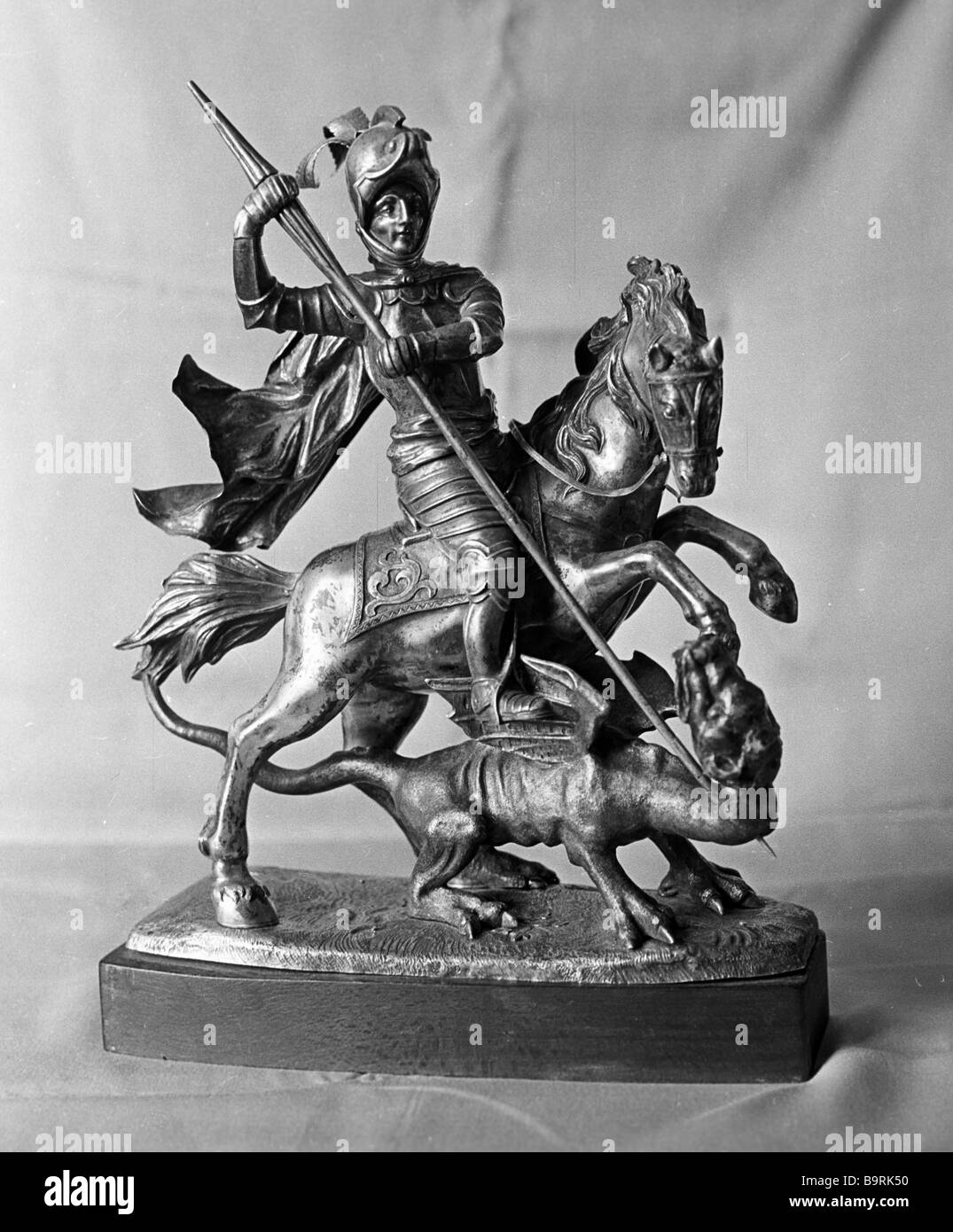 Silver figurine St George Smiting a Dragon with a Spear - Stock Image