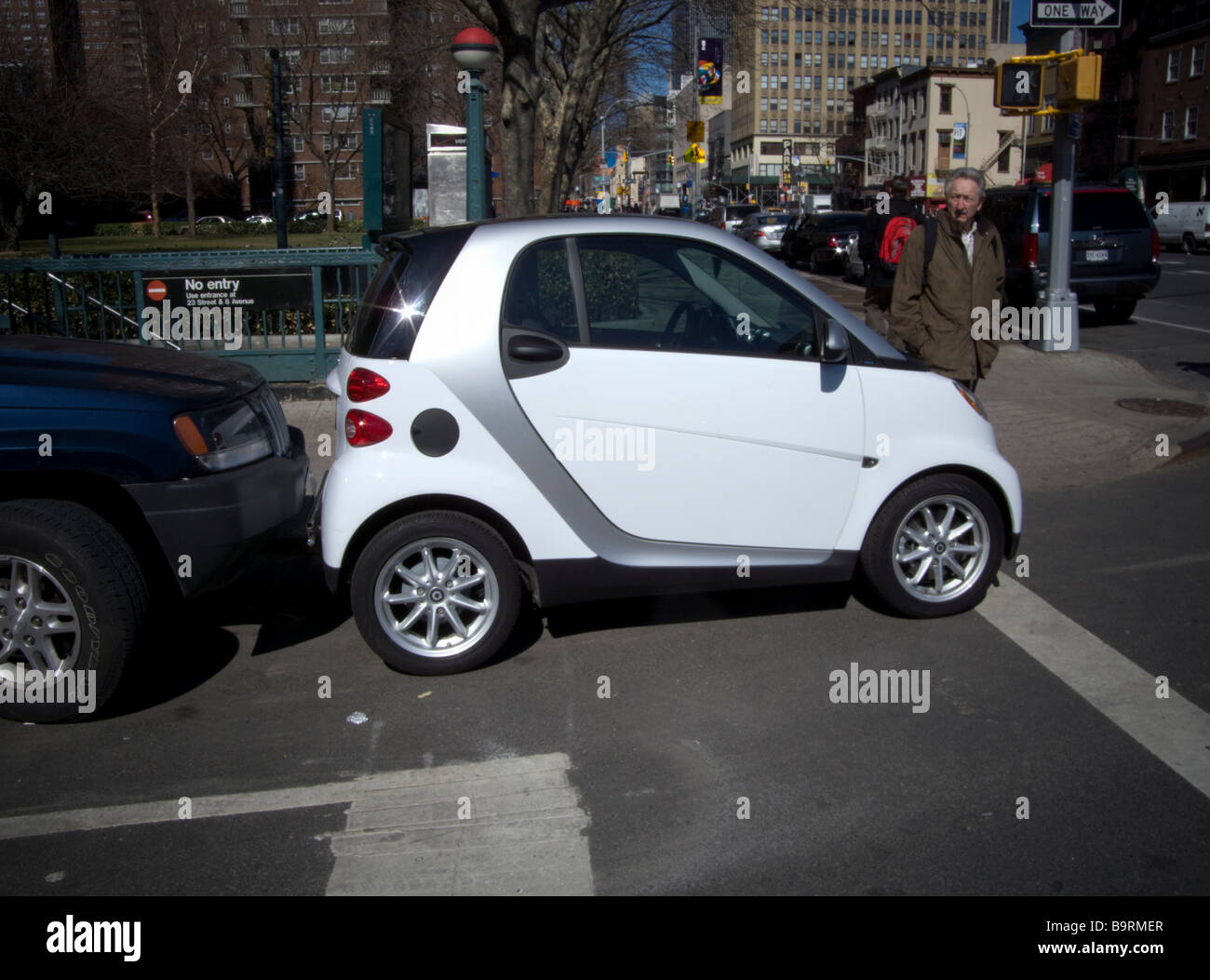 A Two Seat Smart Car Manufactured By Daimler Is Seen Squeezed Into A