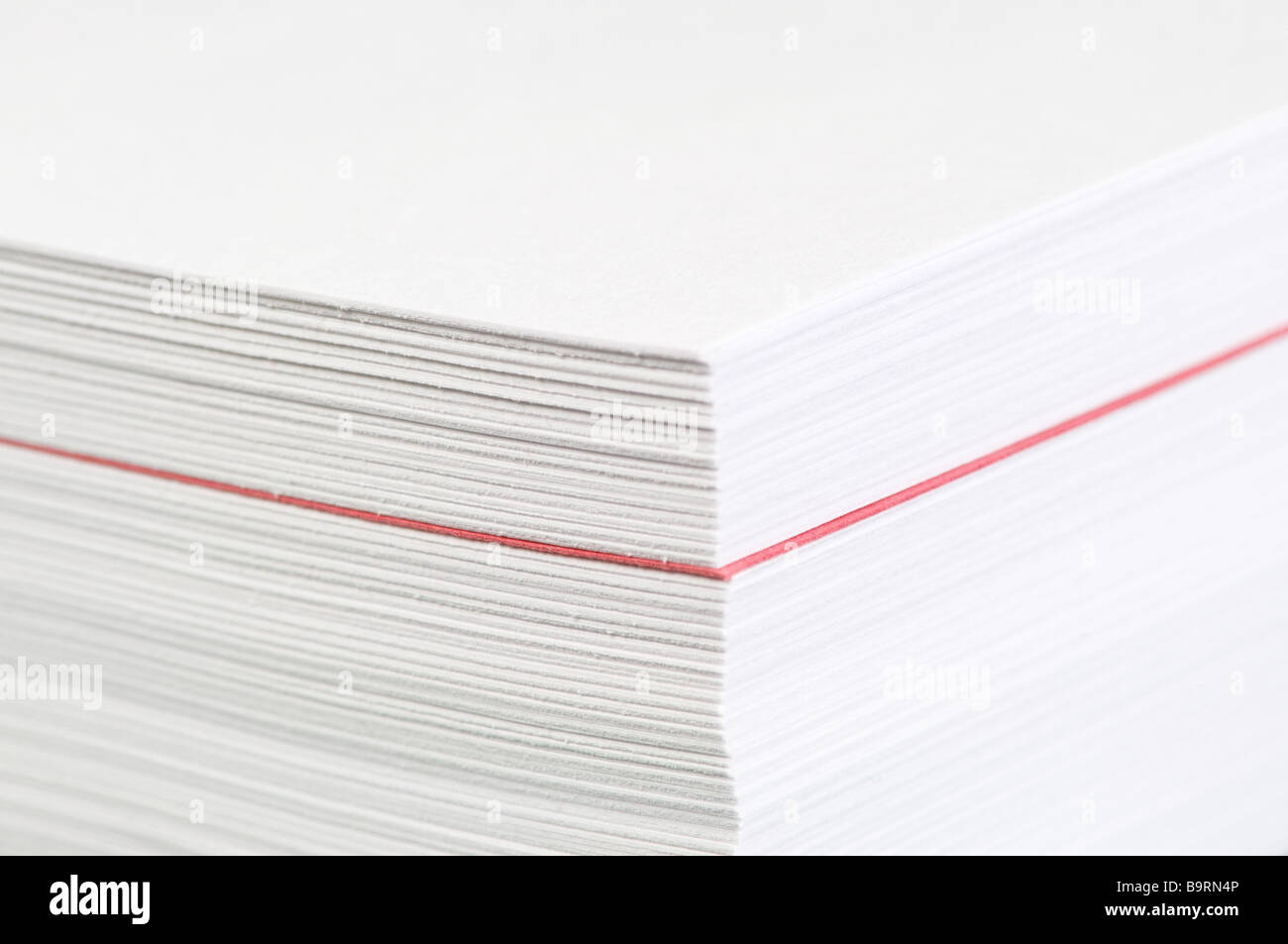 Pile of printer paper with a red