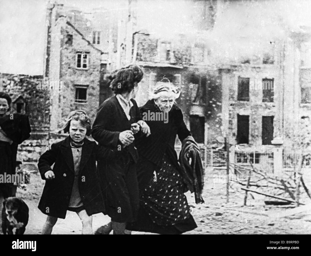 People escaping the destroyed house Fragment of Alexander Medvedkin s documentary Mind Versus Insanity - Stock Image