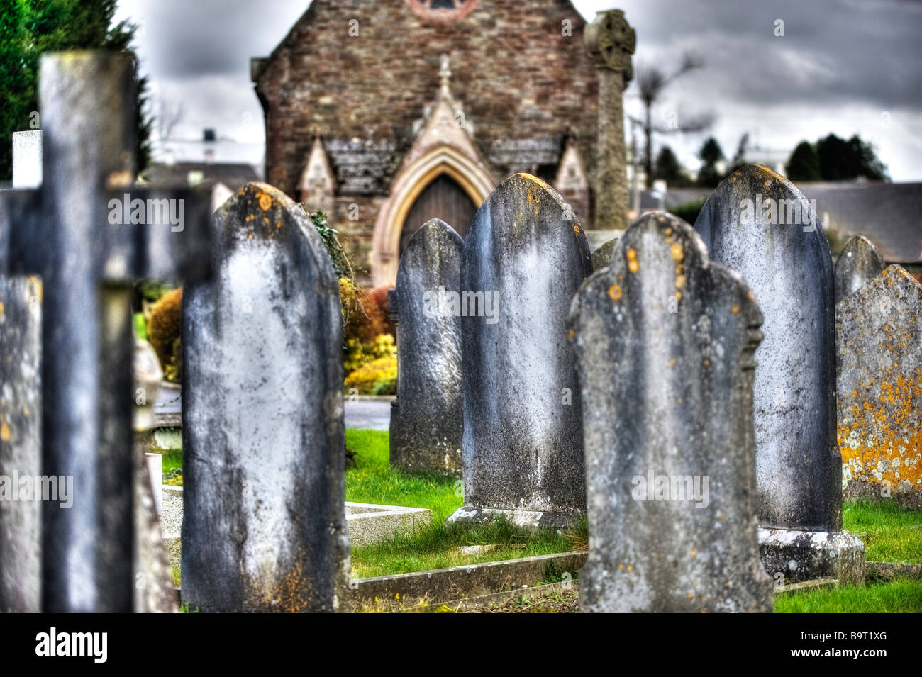 An old church yard in South Molton, Devon in the Untied Kingdom, spring 2009 with a storm rolling in off the sea. - Stock Image