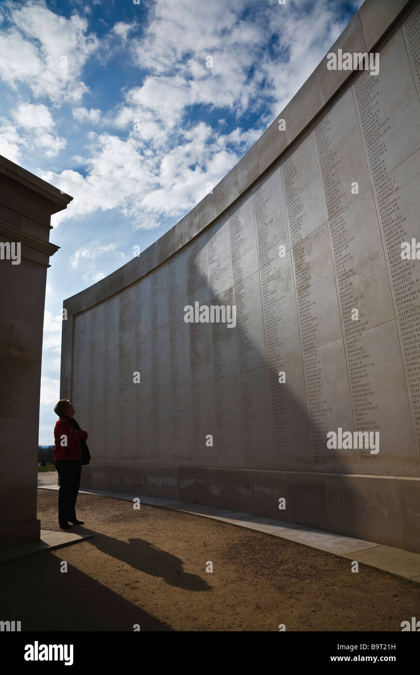 A woman searching the inscribed names on the Armed Forces Memorial, Staffordshire - Stock Image