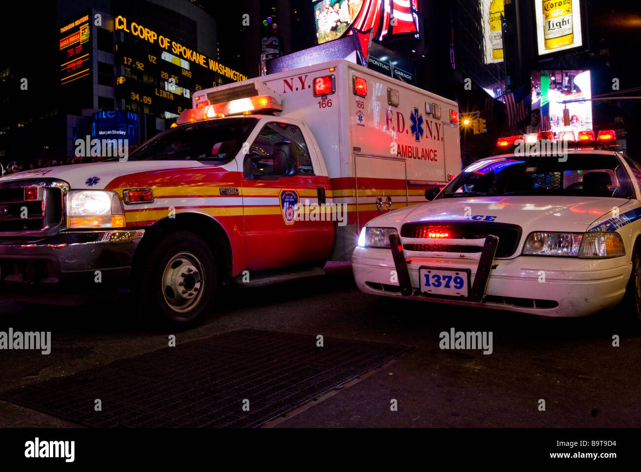 New York Ambulance and New York Police Car deal with an Emergancy at Times Square, New York City, USA - Stock Image