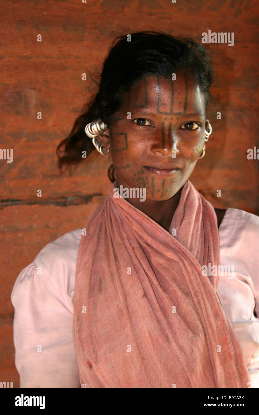 Young Kutia Kondh Tribe Woman with Face Tattoo and Traditional Silver Earrings, Orissa, India - Stock Image