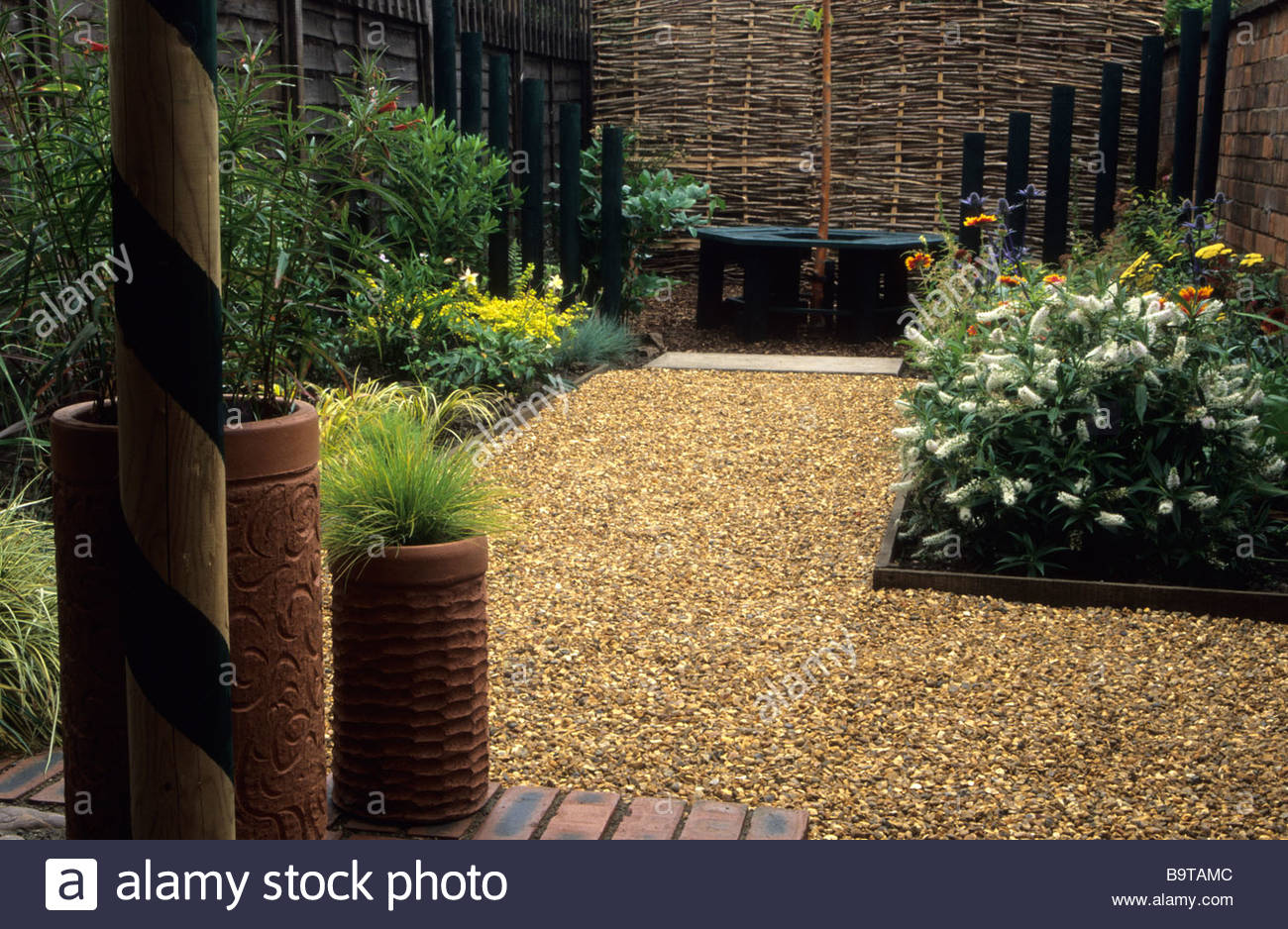 Small Town Garden With Gravel Path Leading To Octagonal