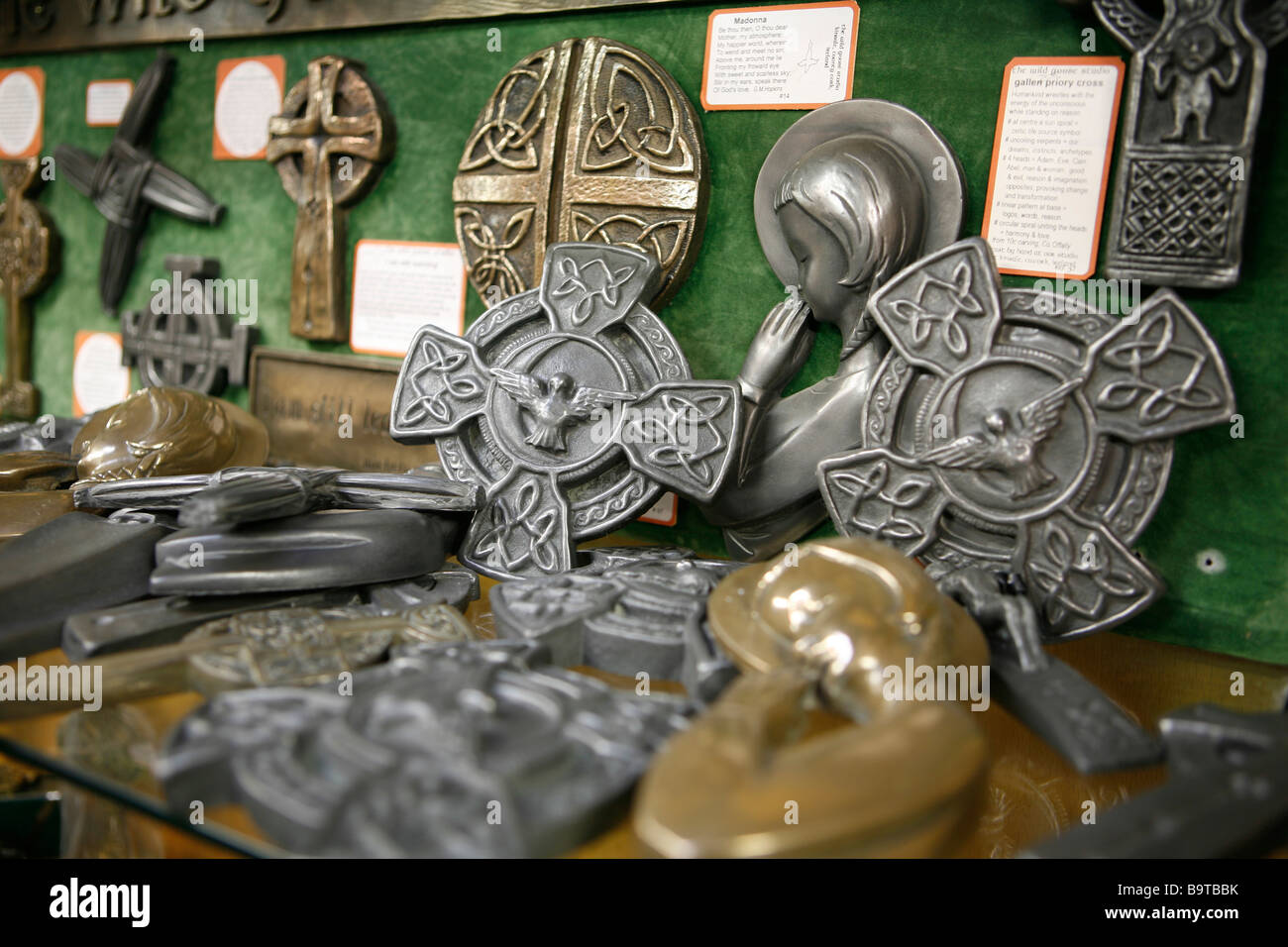 Celtic cross and other souvenirs which are made of peat, Donegal, Republic of Ireland. - Stock Image