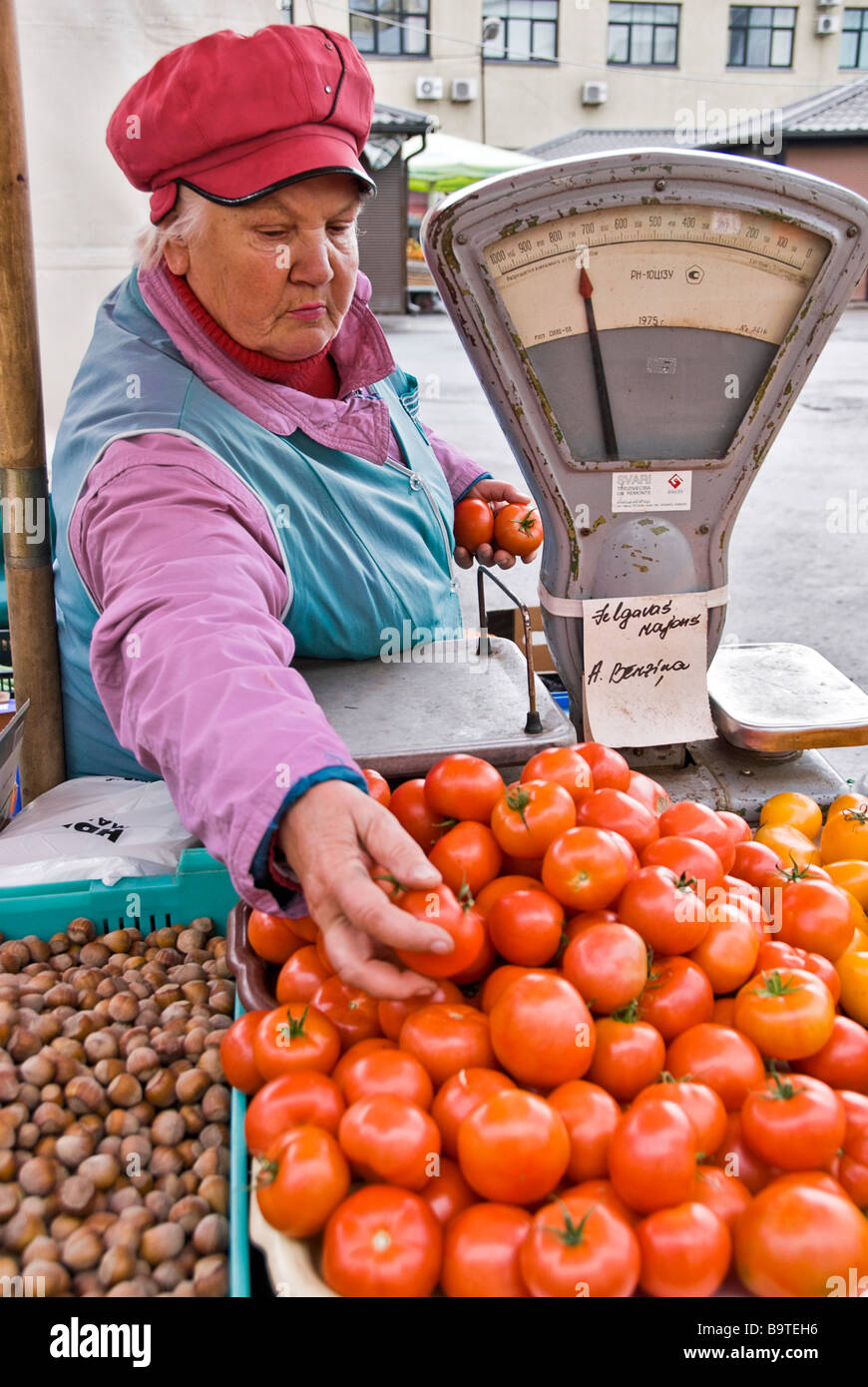 Woman selling tomatoes in a street market, Riga, Latvia, Europe - Stock Image