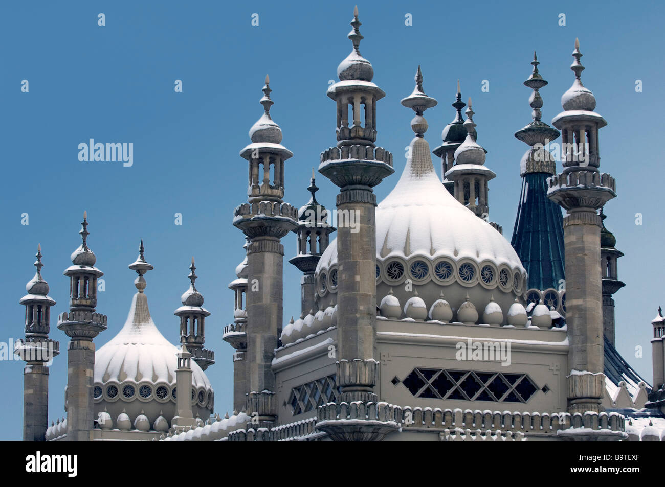 Snow covers the Domes and minarets of the Prince Regents Palace the Brighton Royal Pavilion East Sussex UK Stock Photo