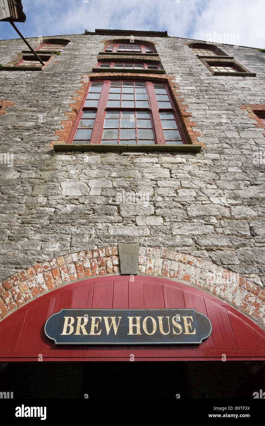 Brew House from below. Looking up at the Jameson Brew House an old stone and brick building with large windows. - Stock Image