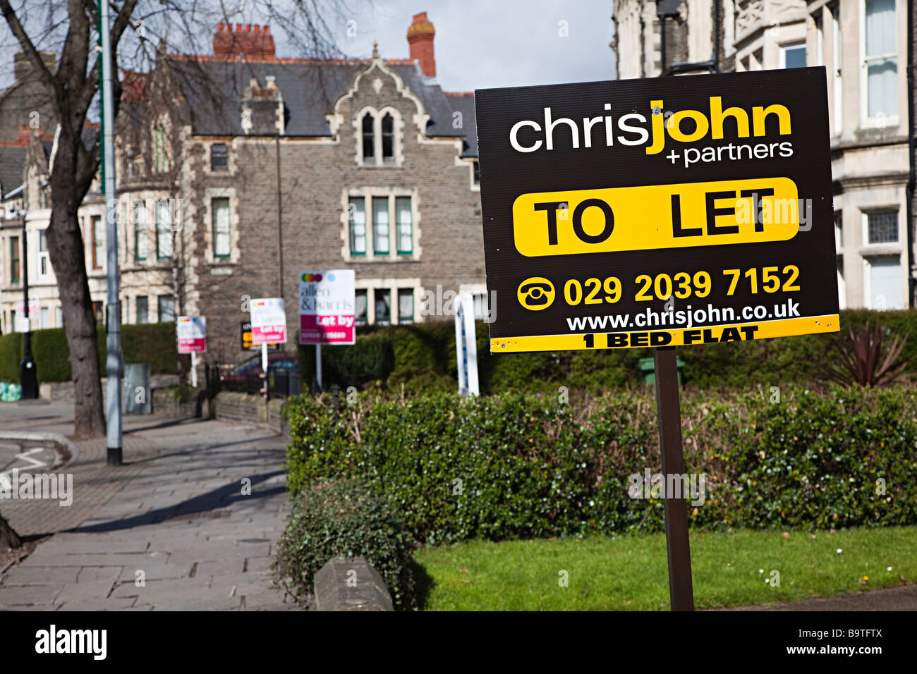 Estate agent sign for flat to let Cardiff Wales UK - Stock Image