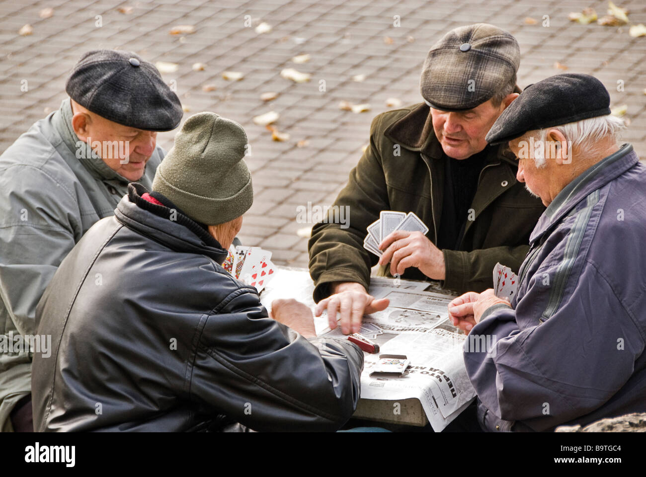 Group of old men playing cards in Wohrmann´s Garden, Riga, Latvia, Europe - Stock Image