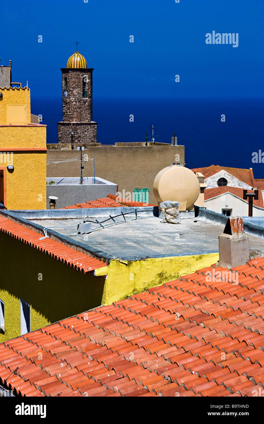 Coloured Roofs and bell tower of Castelsardo's church. Sassari Province. Sardegna. Italy - Stock Image